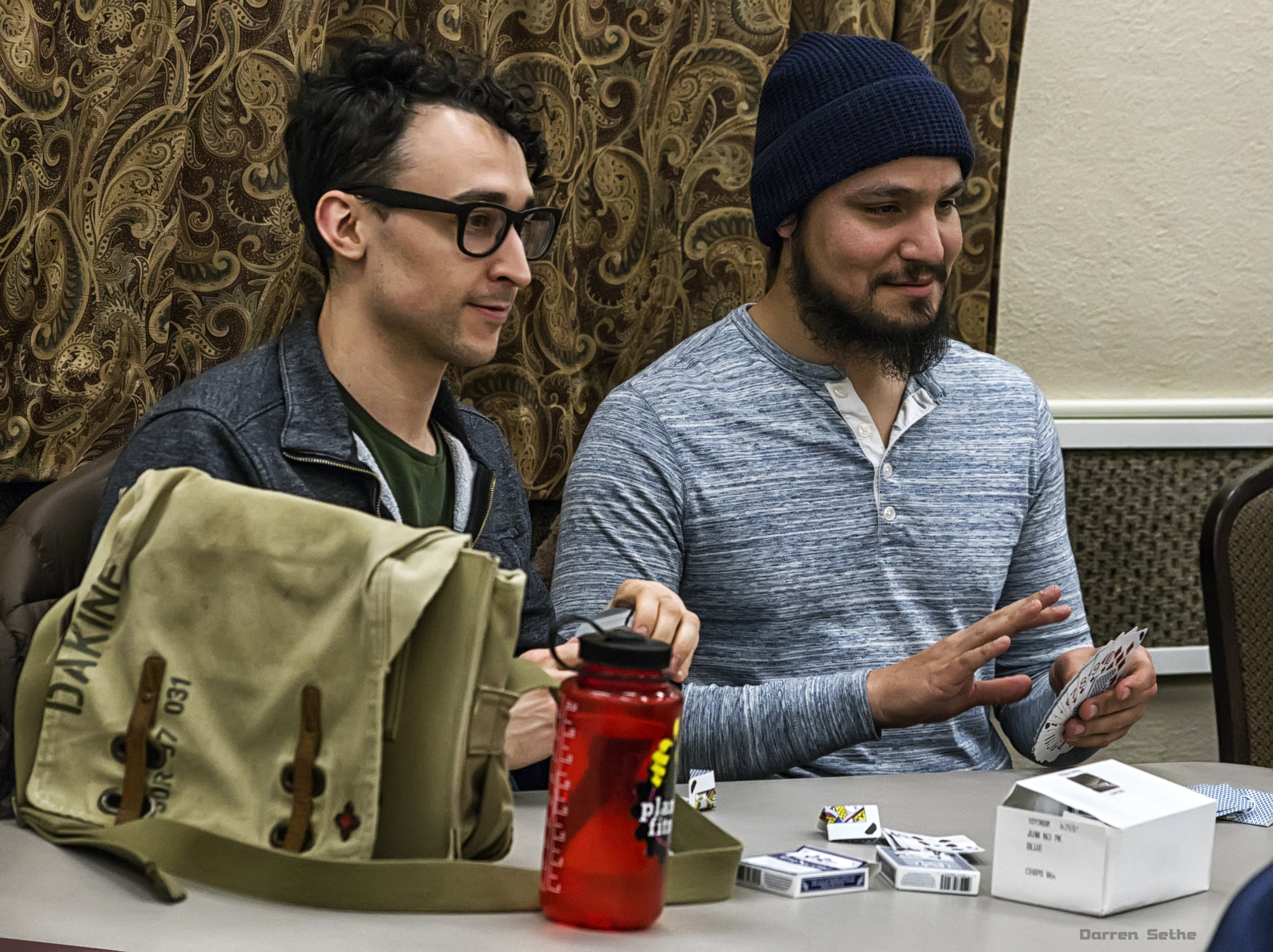 Frank Brislawn and Joseph Ruiz get free boxes of cards, and then decide to destroy everyone of them practicing their Mercury Card Folds (photo by Darren Sethe 2019)