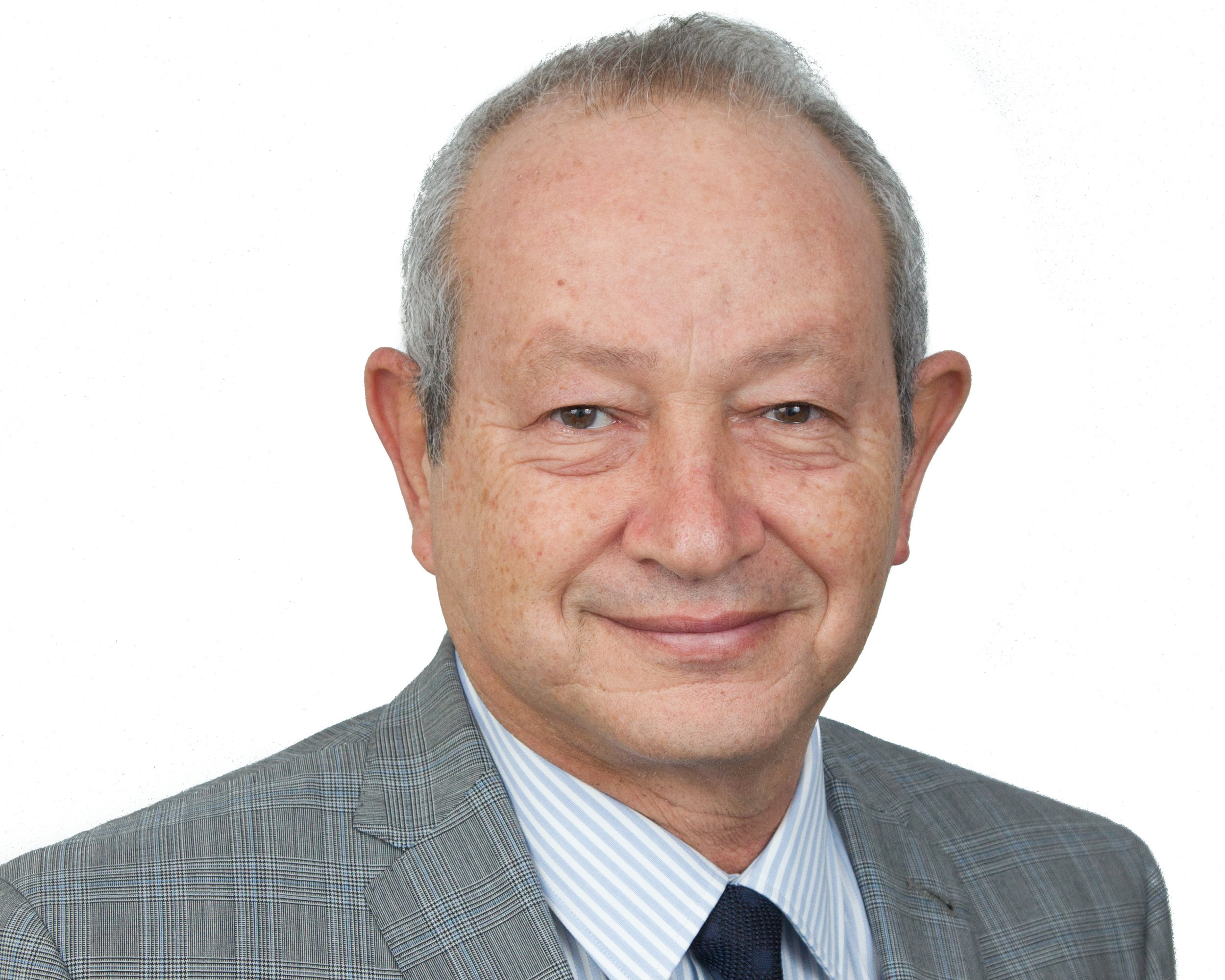 "Mr. Naguib Sawiris founded Orascom Telecom Holding (OTH) and led it to become the leading regional telecom player until the much-publicized merger deal with VEON (formerly VimpelCom Ltd.), creating the world's sixth largest mobile telecommunications provider in April 2011.  Mr. Sawiris is Executive Chairman of Orascom Investment Holding, a holding company investing in industries that are critical to shaping the future, including energy, financial services, agri-industries, real estate development, logistics and transport.  Mr. Sawiris is Chairman of La Mancha Holding, the private natural resource investment vehicle of the Sawiris family group with equity investments in Evolution Mining, Endeavour Mining and Golden Star Resources.  Mr. Sawiris is also Chairman of Ora, a company undertaking high-end real estate developments in various prime locations around the world.  In 2015, the Sawiris family acquired a majority stake in Euronews where Mr. Sawiris is Chairman of the board. The Sawiris family also has ownership in several assets in the media business in Egypt.  At international and regional levels, Mr. Sawiris served and is serving on a number of boards, committees and councils including International Advisory Committee to the New York Stock Exchange (NYSE), International Advisory Board to the National Bank of Kuwait, London Stock Exchange Group's Africa Advisory Group, External Advisory Council to the Global Institute for Advanced Study at NYU, the Boards of Trustees of Nile University (NU), the French University in Egypt (UFE), and the Arab Thought Foundation.  Mr. Sawiris is also the recipient of numerous honorary degrees, industry awards and civic honors, including the ""Legion d'Honneur"" (the highest award given by the French Republic for outstanding services rendered to France). In July 2011 Mr. Sawiris was awarded the Honor of Commander of the Order of the ""Stella della Solidarietà Italiana"" (Star of Italian Solidarity). In 2006, the prestigious ""Sitara-e-Quaid-e-Azam"" award was conferred upon him by General Pervez Musharref for services rendered to the people of Pakistan in the field of telecommunication, investments and social sector work.  Mr. Sawiris holds a diploma of Mechanical Engineering with a Masters in Technical Administration from the Swiss Federal Institute of Technology Zurich (ETH Zürich) and a Diploma from the German Evangelical School, Cairo, Egypt."