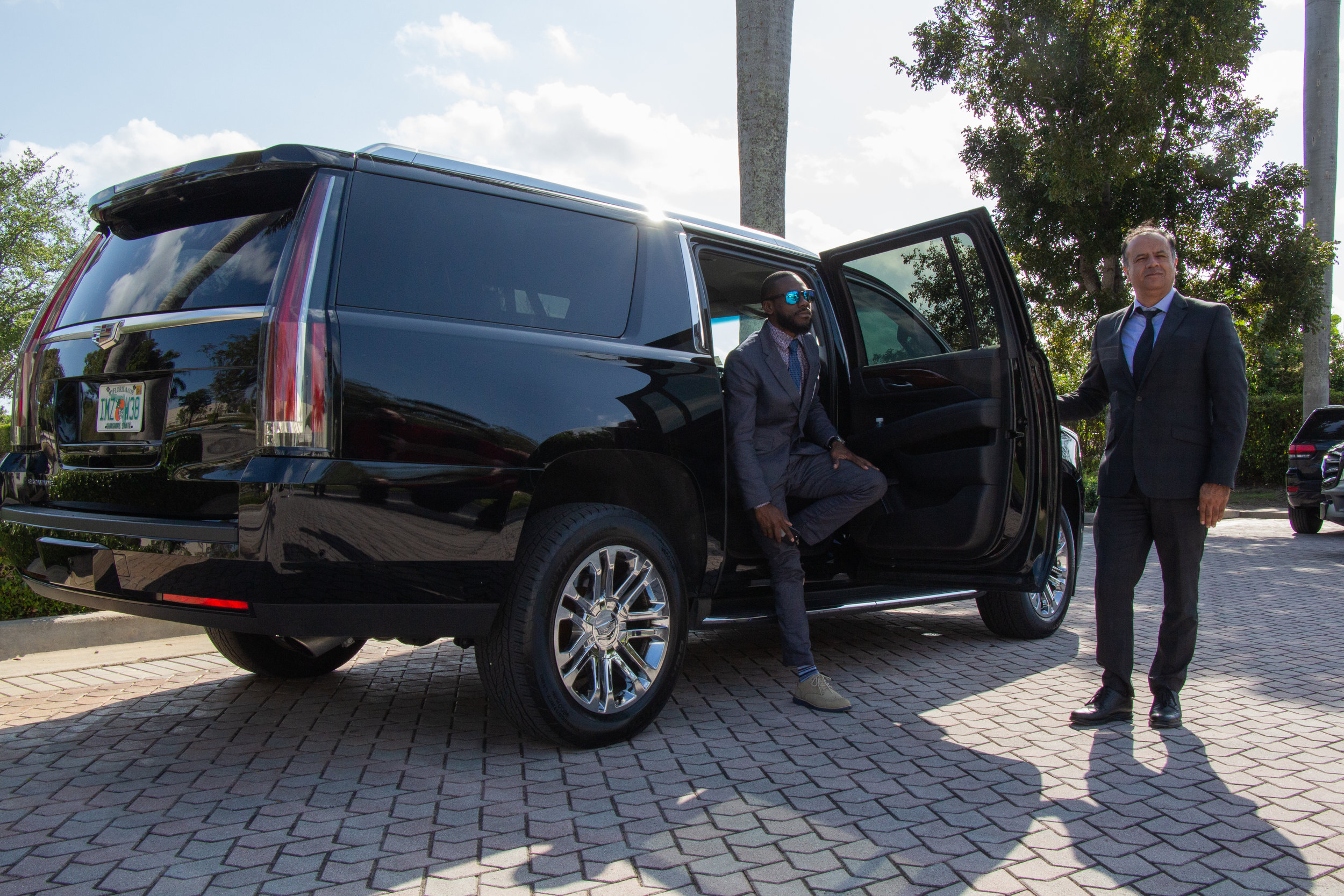 Cadillac Escalade ESV with chauffeur and client