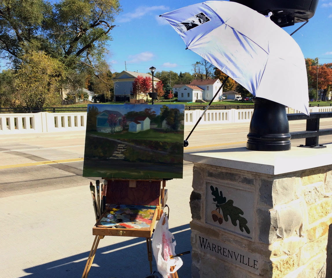 Photo courtesy of Maggie Capettini, 2016 Artist-in-Residence and 2019 Paint the 'Ville co-curator, plein air painting on the DuPage River in Warrenville.