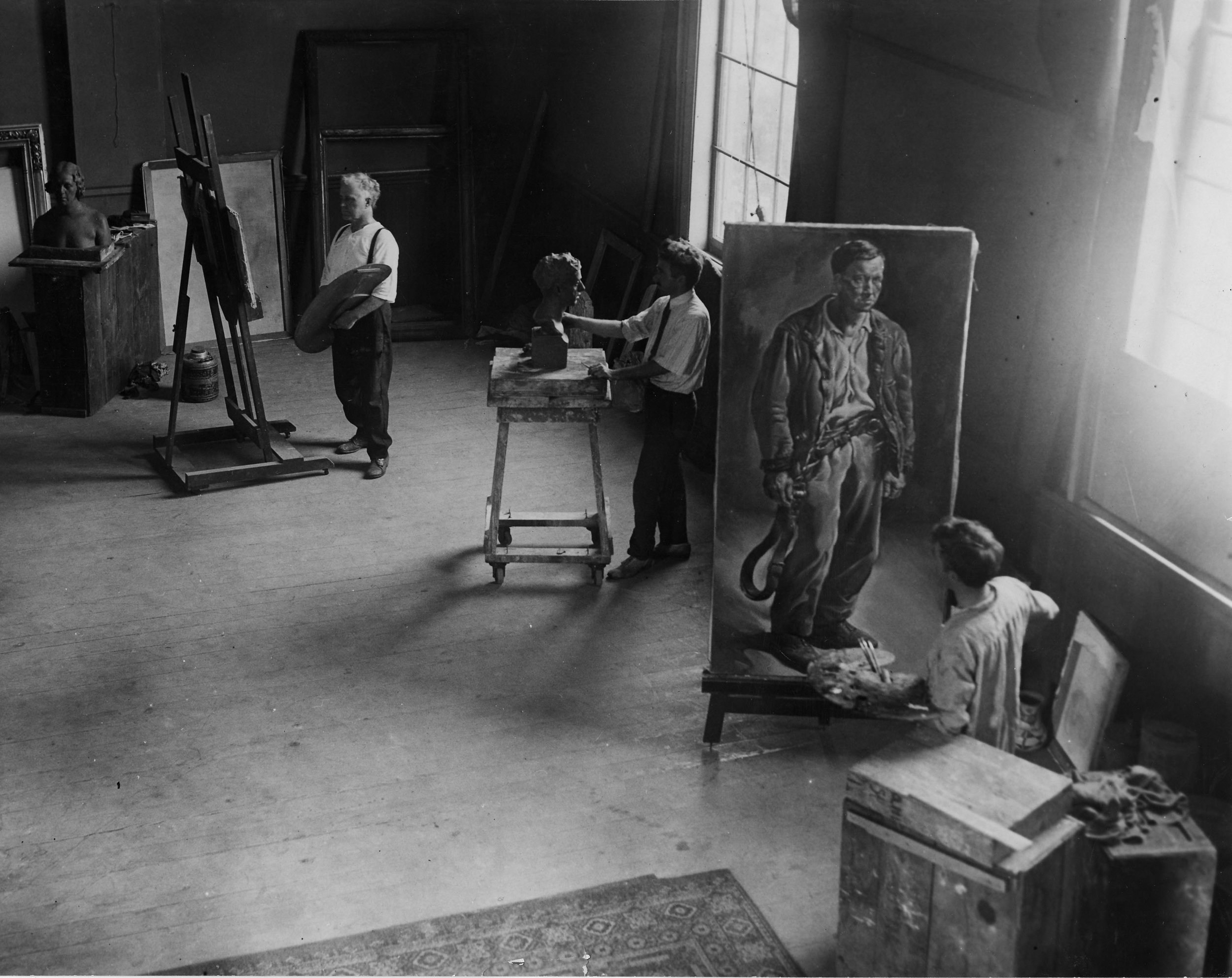 Adam Emory Albright working alongside his twin artist sons, Ivan and Malvin, in the Albright Studio, now the home of the Warrenville Historical Museum