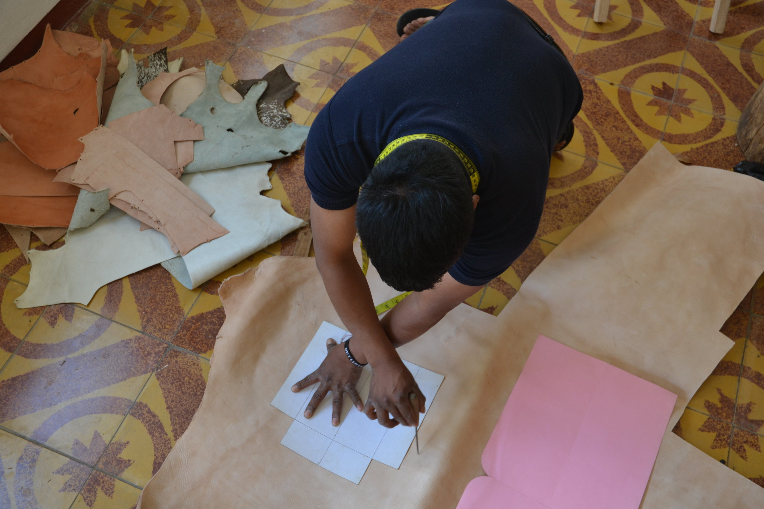 Elias, the leader of the group, working on Maria Maria Studio designs.