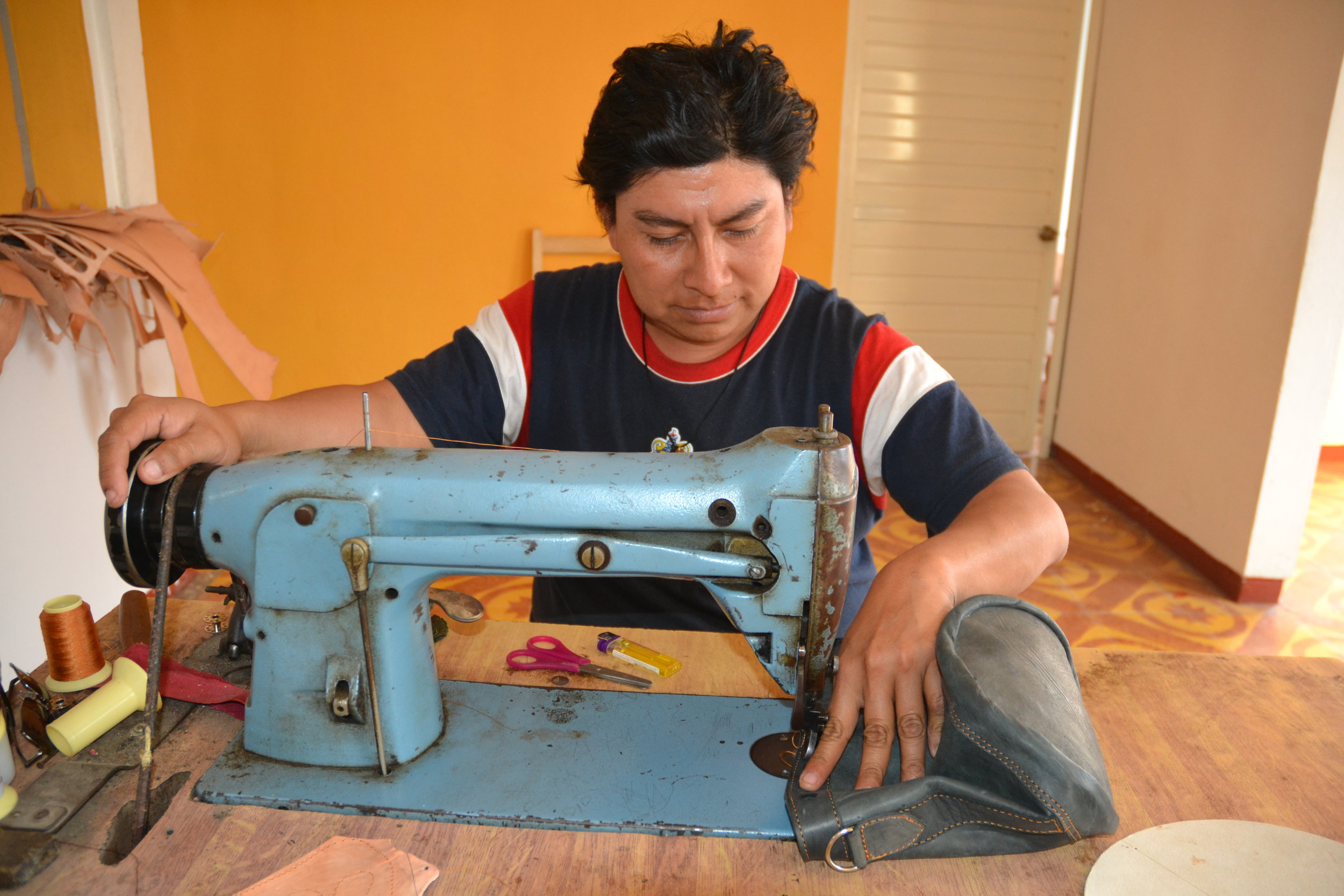 Juan Manuel is a musician by night and a leather worker by day. He plays 6 instruments and one at the workshop (the sewing machine!). He is Caralampio´s son and although he has been learning from his dad his whole life, it wasn't until recently that he started calling this his job.