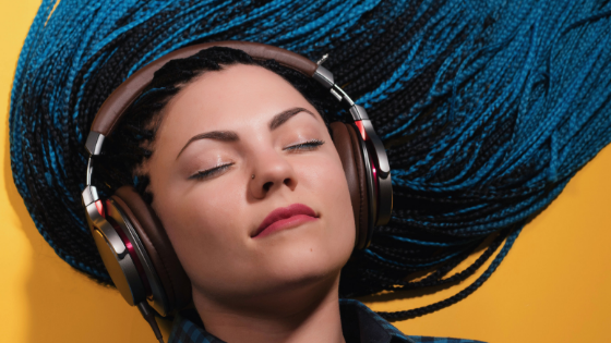 podcast equipment essentials woman listening to a podcast