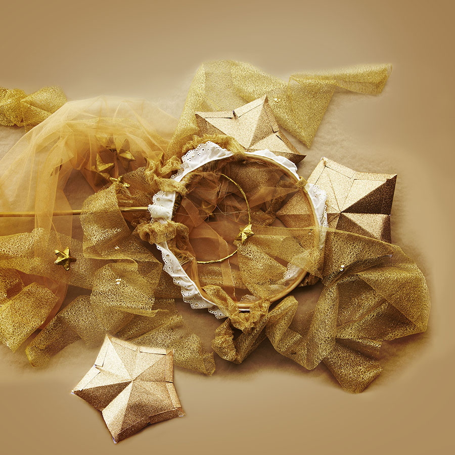 Feature 2 - Golden glittered 3d stars and handmade dreamcatcher net with gold lacquered paper maché stars.