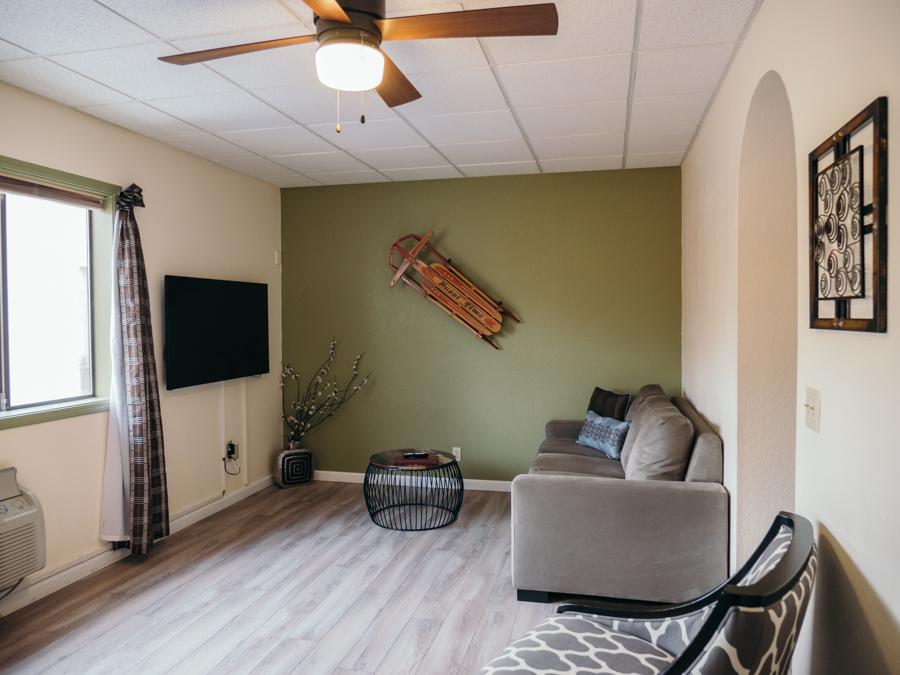 living area in adventure inn hotel room with sleeper sofa