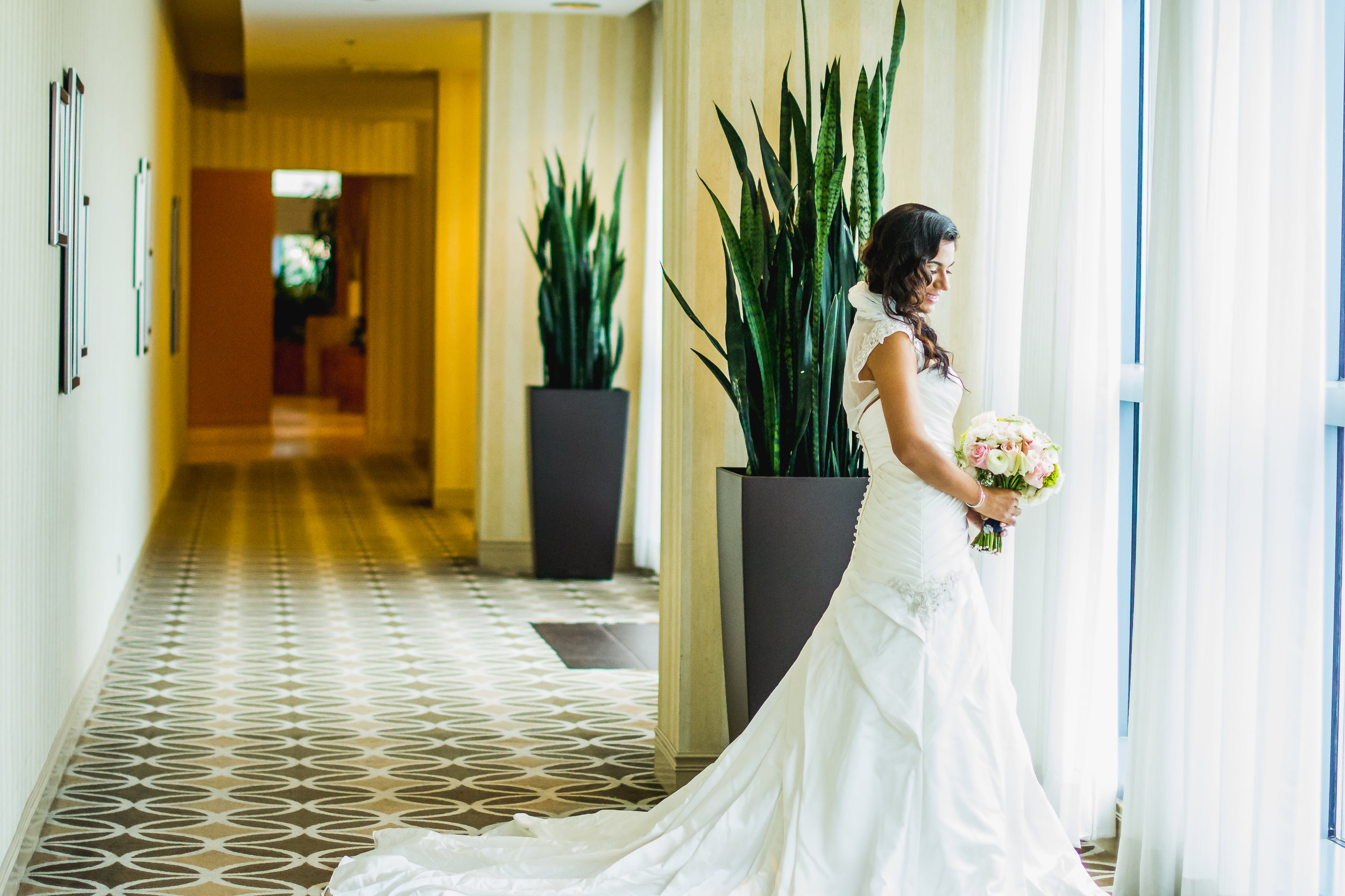 Imani J Portraits_Wedding Photographer_Melbourne Florida_Hilton Rialto_window pose6 (1 of 1).jpg
