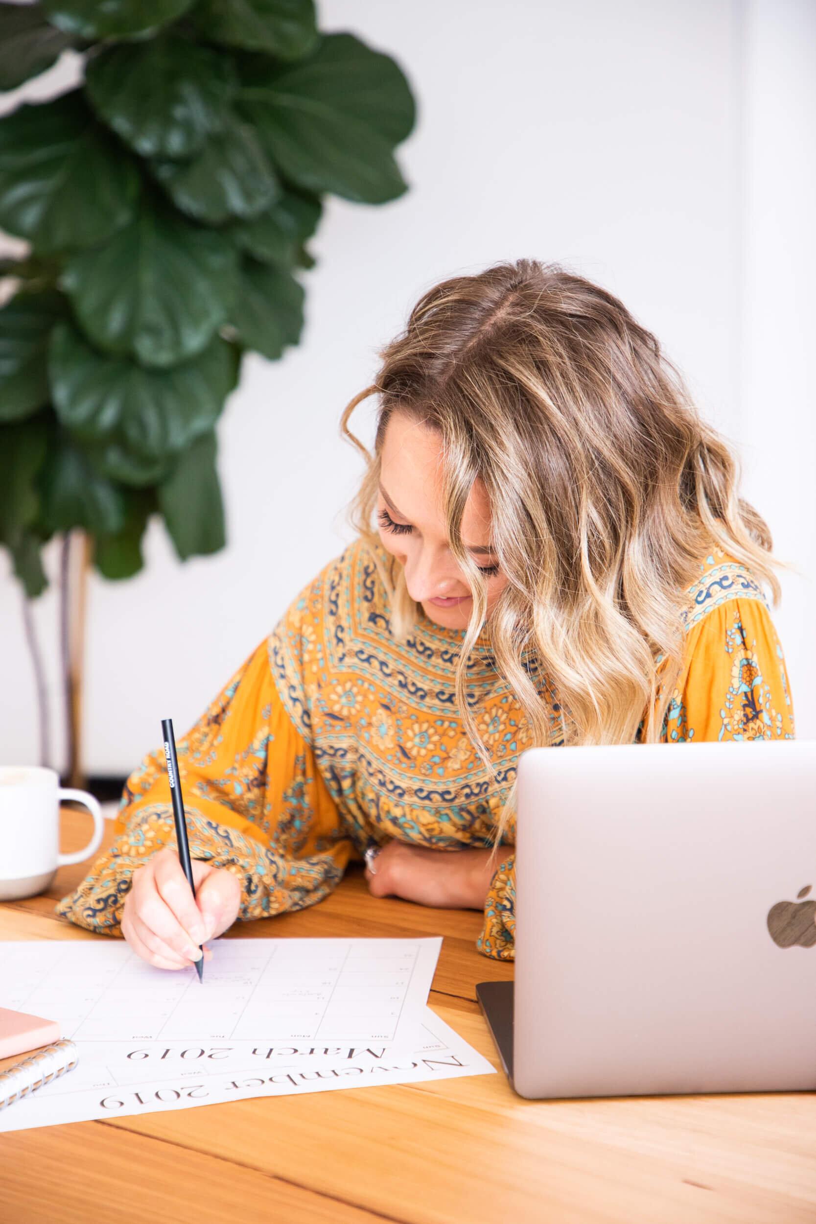 Lauren writing at desk.jpg