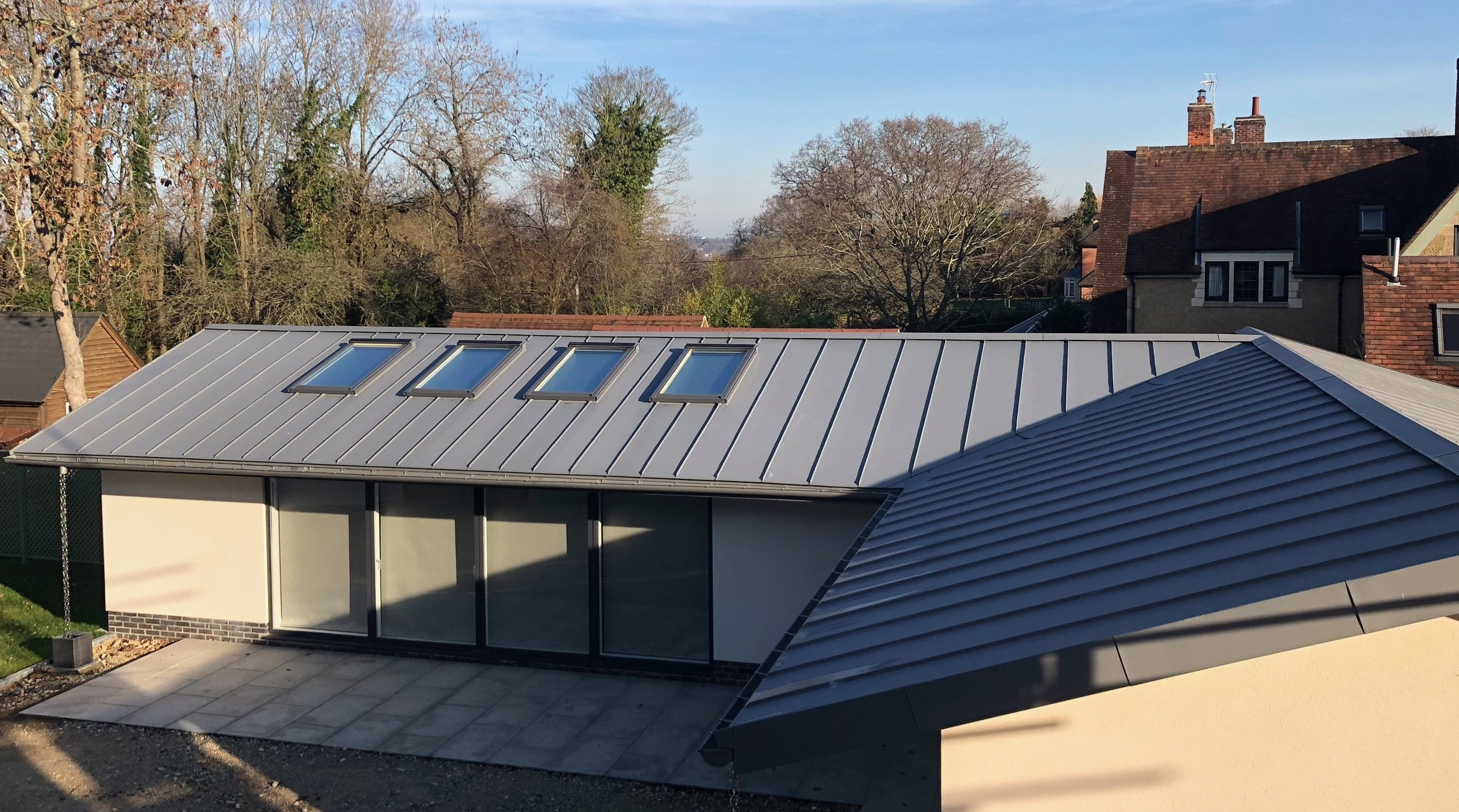 HINKSEY HILL HOUSE - The large extension and annex building at this big renovation project in oxford were completed in 2019. VM quartz zinc was used on both the renovation of the old house as well as on the outbuildings and porch.