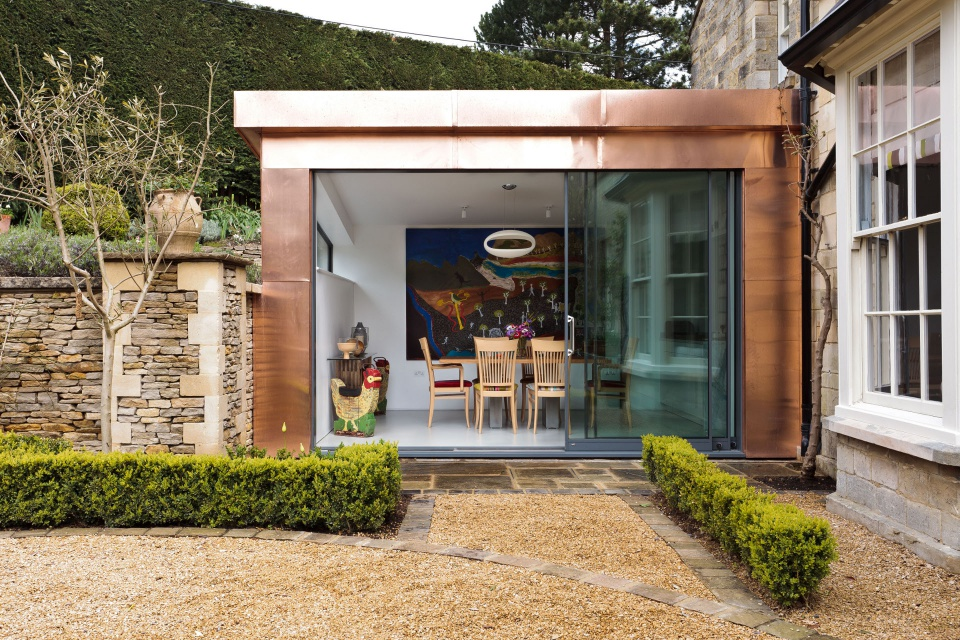 OLD PARSONAGE - The modern sleek extension to this historic building is framed using copper cladding and fascia.This is another Variety & Beverly architectural design.
