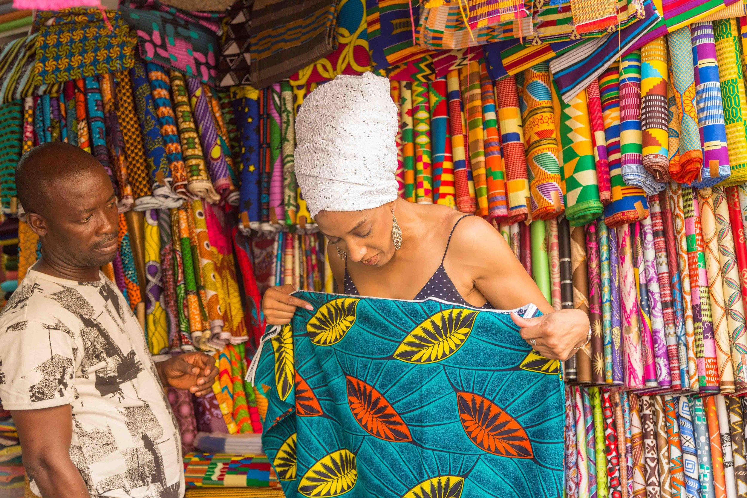 26. Choosing fabrics at makola Market .jpg