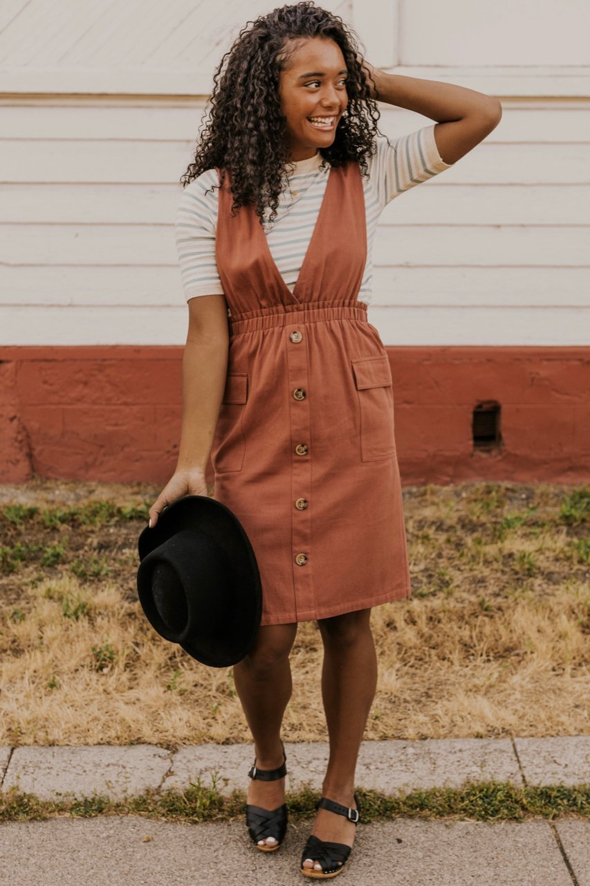 The Overall Dress - Look chic and stay comfy in these playful pieces. These jumpers come in so many styles and materials and are amazing for layering. Perfect for throwing on over a turtleneck and tights, these pieces will make you look cool while the temperature drops.-Roolee Cathan Button Jumper (Pictured)-Anthropologie Hattie Dress