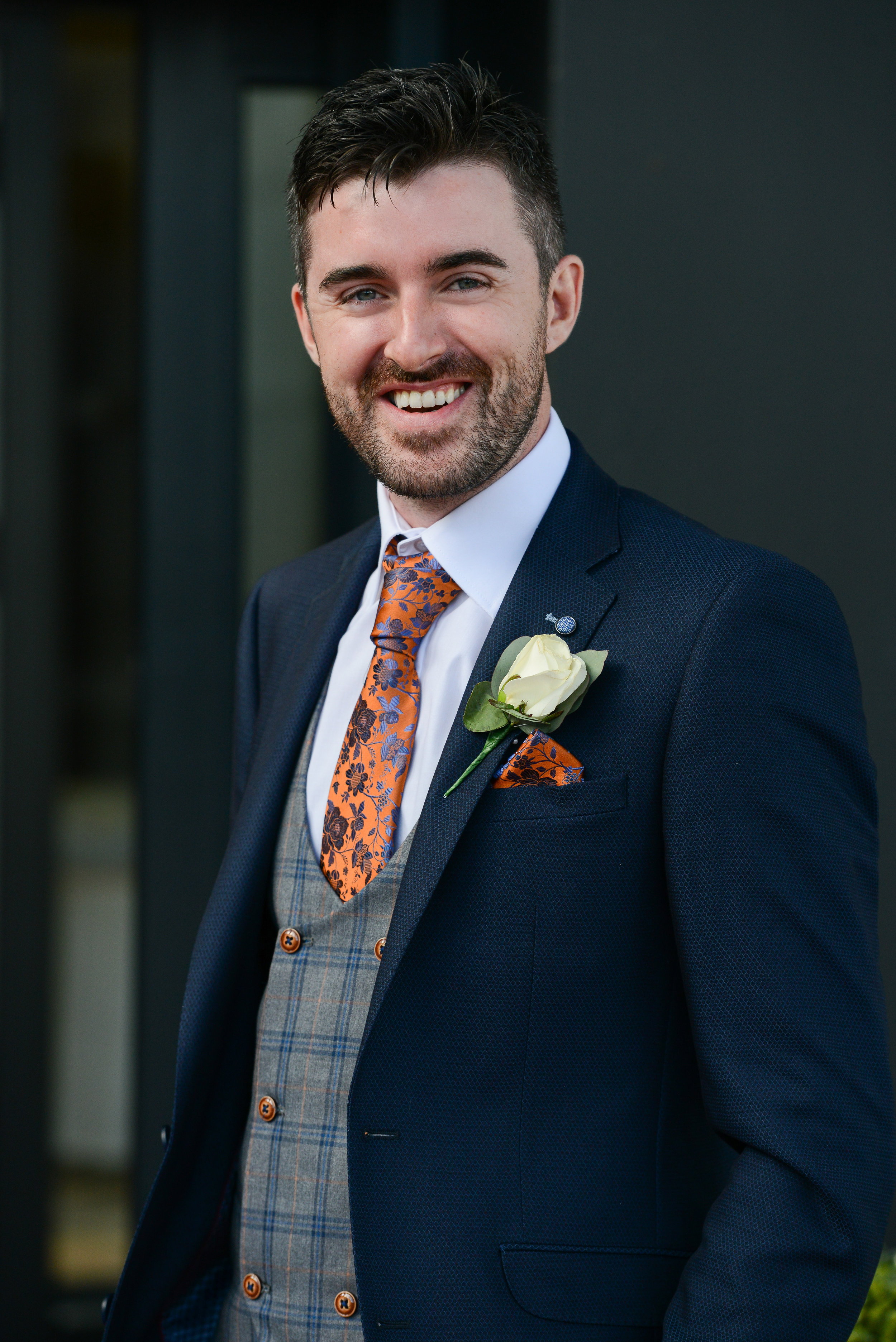 groom lee looking handsome with this quirky navy blue suit with orange floral tie , supplied by Statement Mens Wear (Portadown
