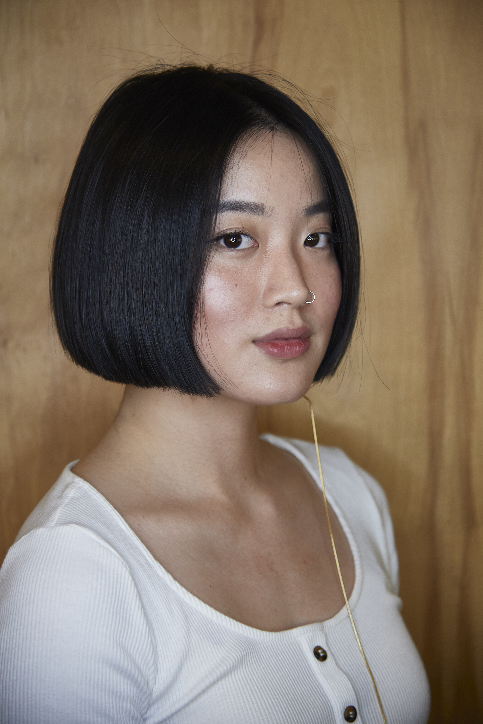 Lenny's demure classic bob features inward curvature: the mark of a technically precise bob cut.