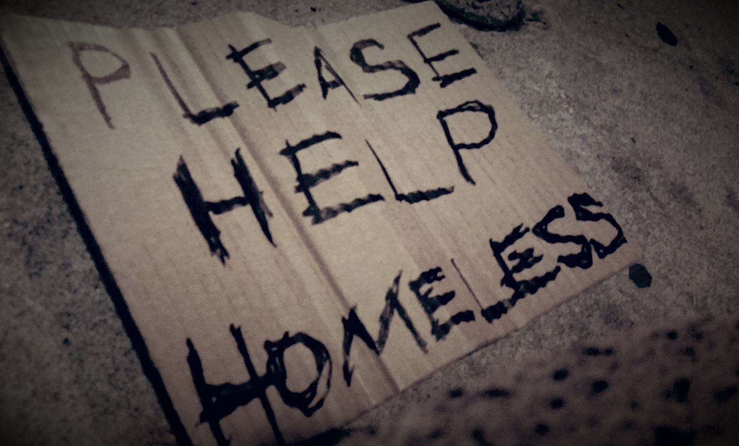 Discarded homeless sign on the streets of Nashville.  Photo: © 2017 Jeb Johnson