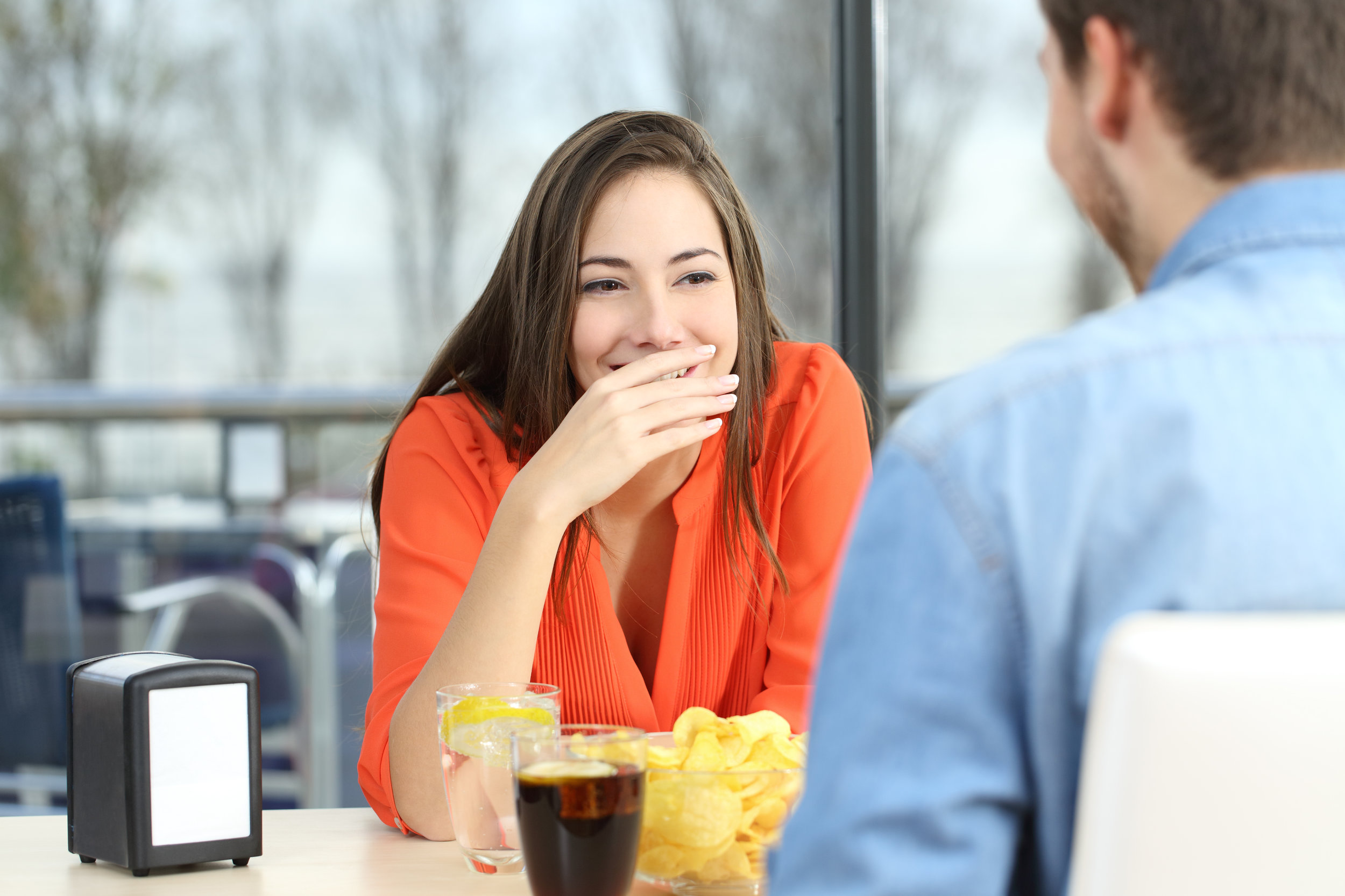 Woman+covering+her+mouth+to+hide+smile+or+breath.jpg