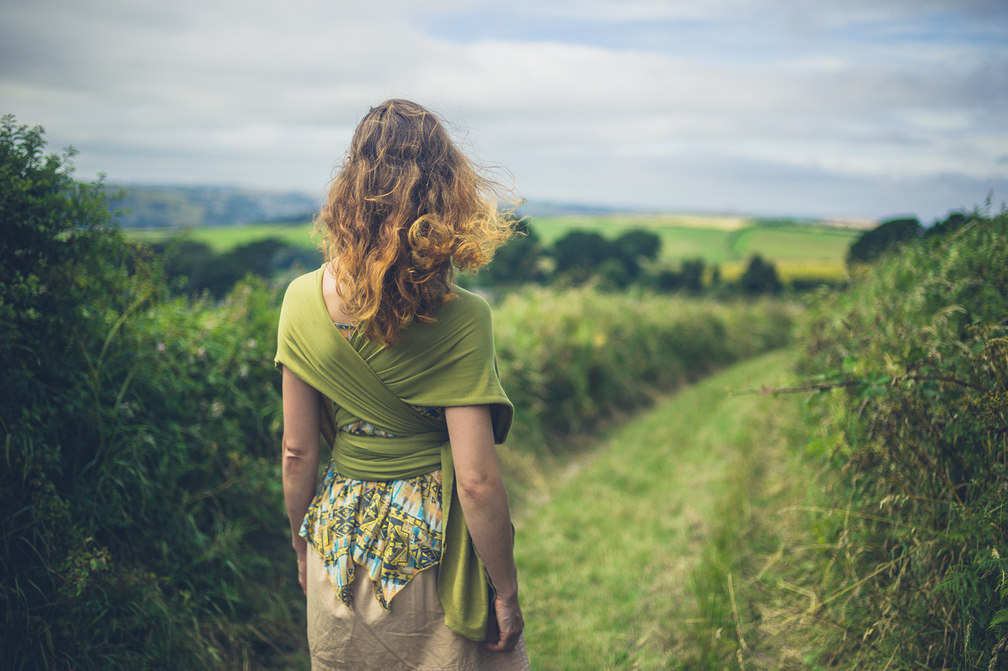 woman-practising-mindfulness-in-a-field.jpg
