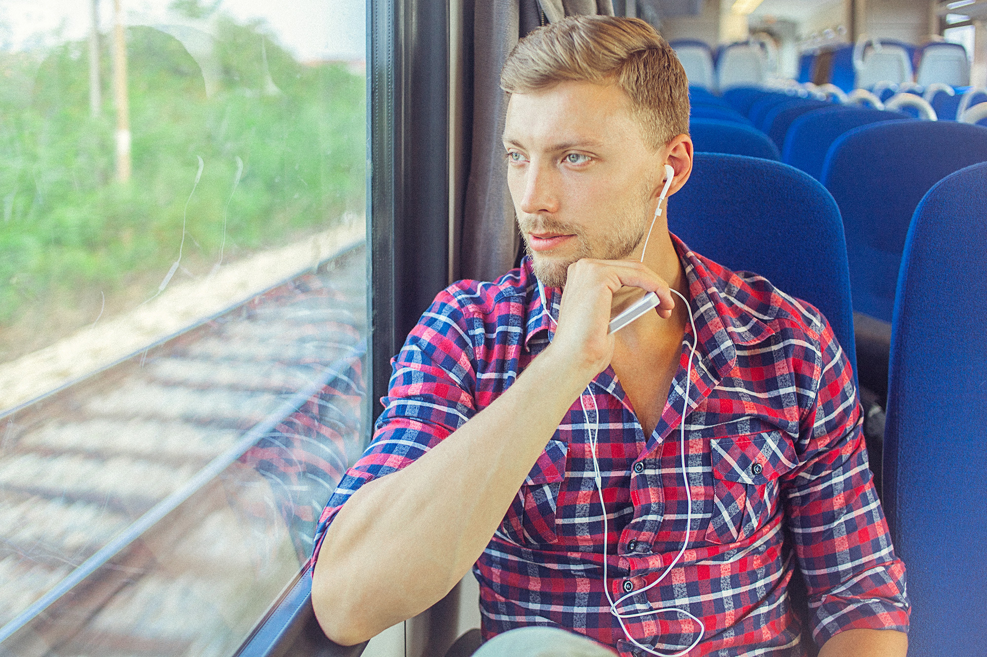 man-practising-mindfulness-on-a-train.jpg