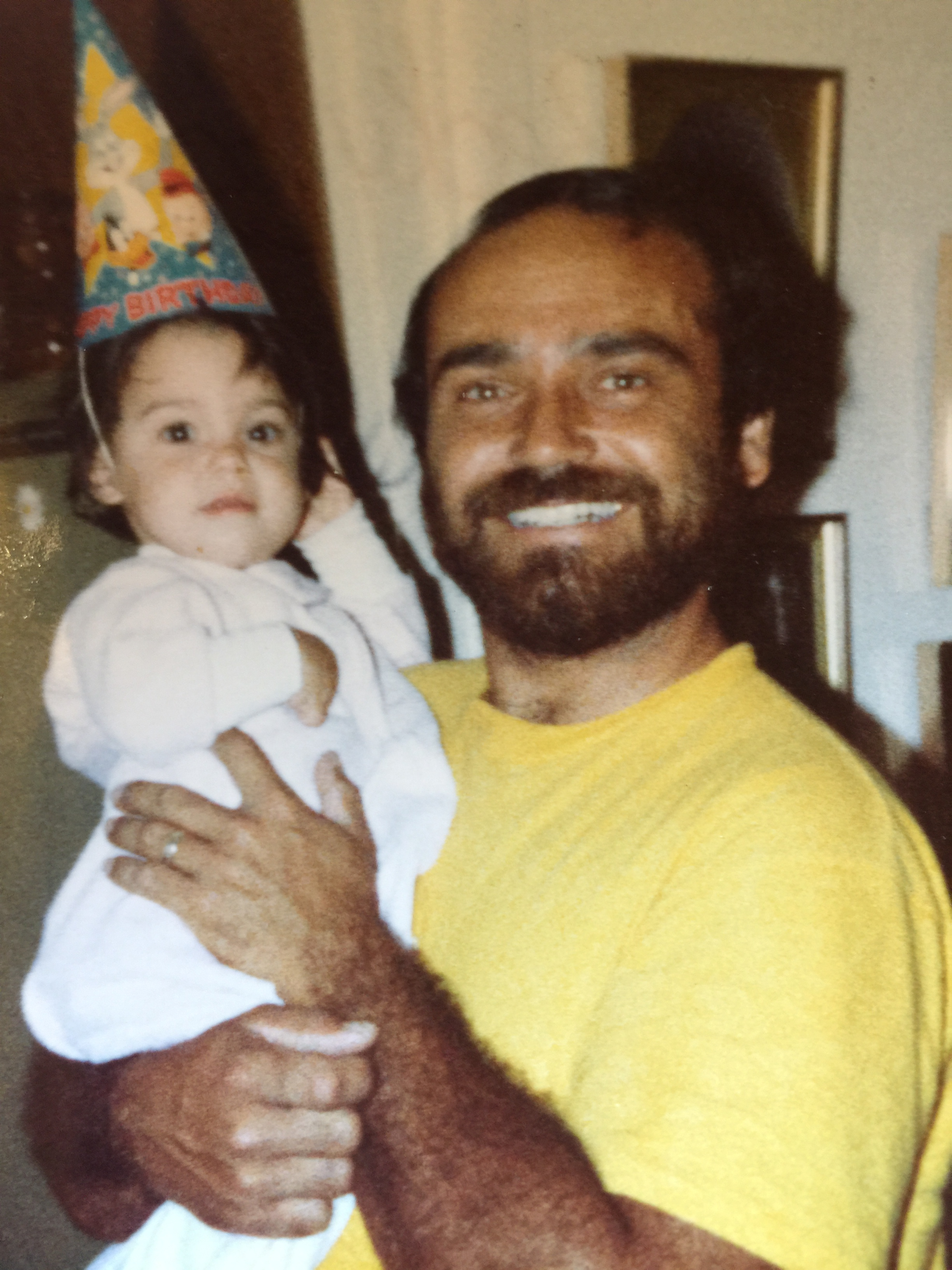 My Dad and I on my first birthday