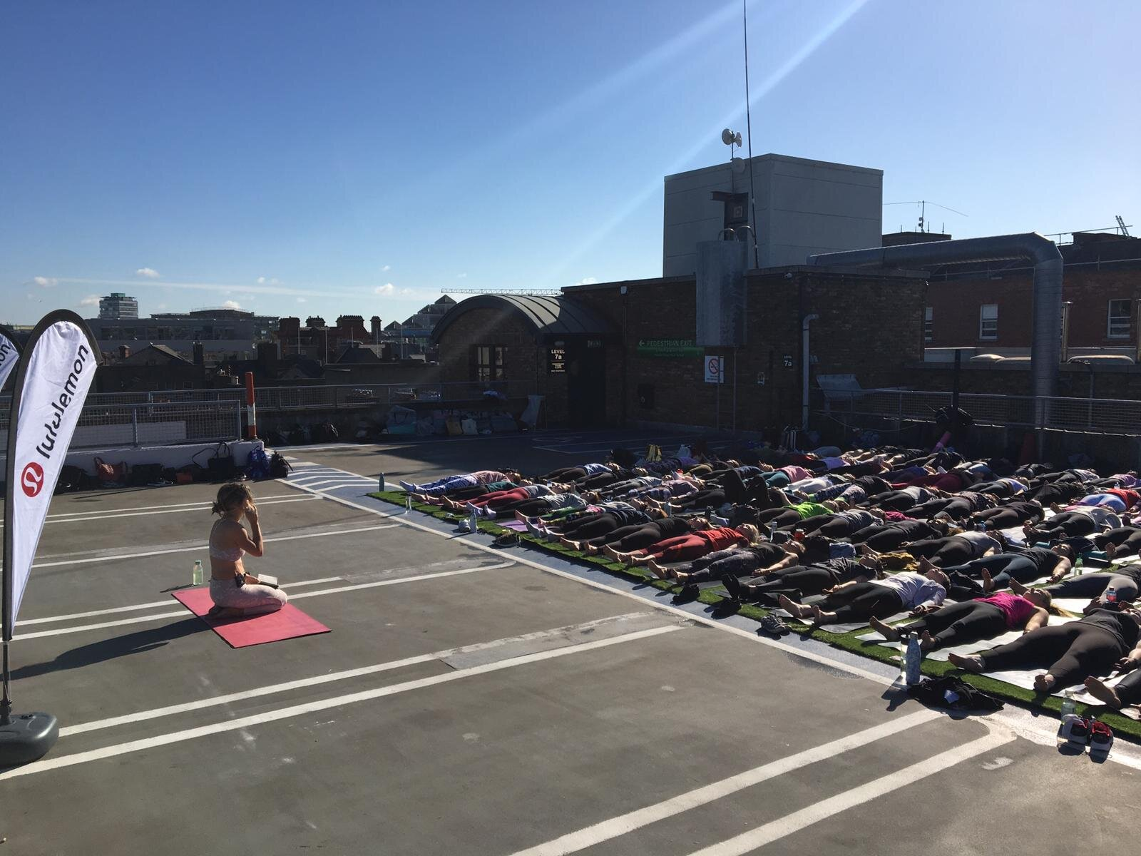 international yoga day with lululemon - Yoga with Sarah on the rooftop of Brown Thomas June 2019. Read about How Yoga Improved My Life in the writing section.