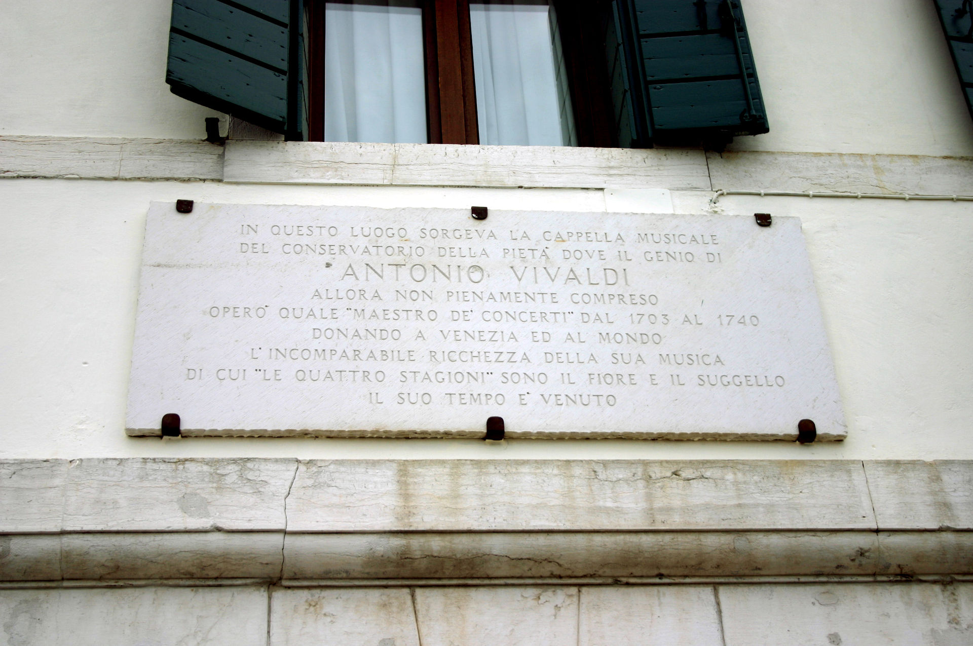 Commemorative plaque beside the Ospedale della Pietà (Devout Hospital of Mercy) in Venice.