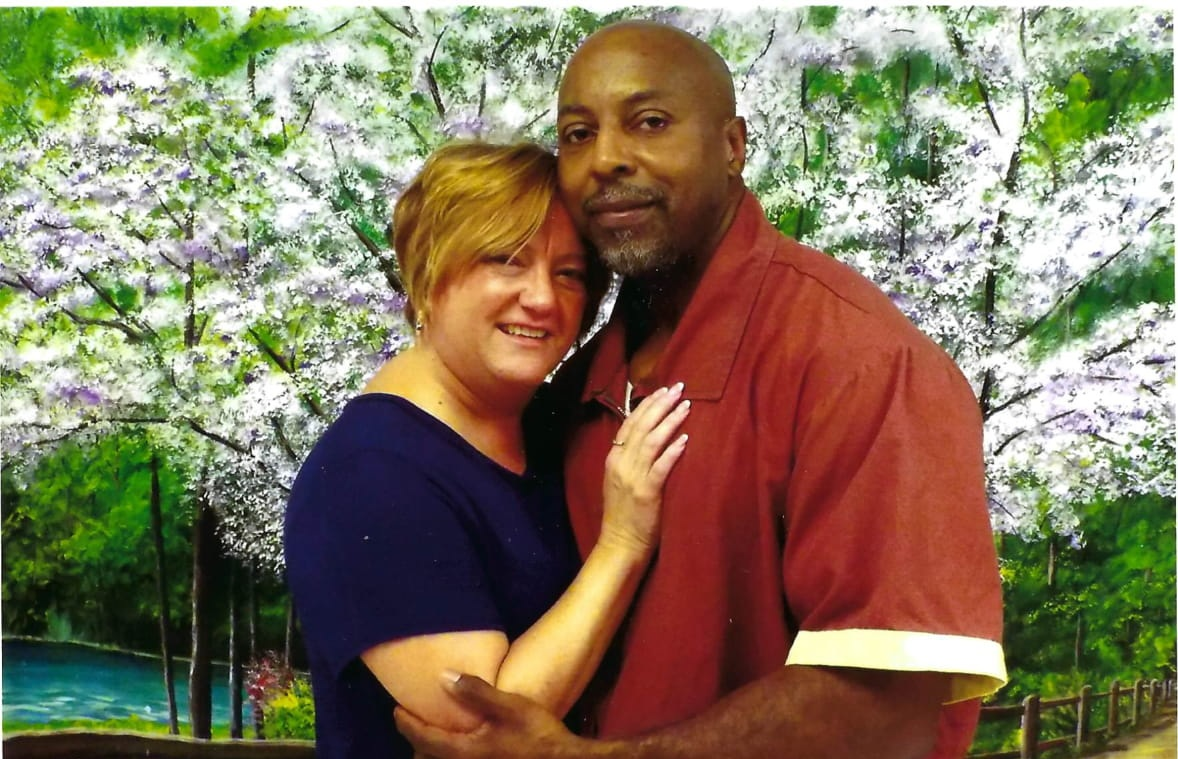 """JOHN AND KAREN BROOKINS - Karen Pollard-Brookins first met John at church when they were nine years old. Each other's """"first loves"""" as young adults, the two fell out of touch as the years went by. They reconnected five years ago after Karen wrote a letter about John for his appeal process. Since they reconnected, Karen has dedicated her life to tirelessly working to free Johnny, gathering a huge amount of documents and becoming the go-to person for details about the case. The two married in November 2018."""