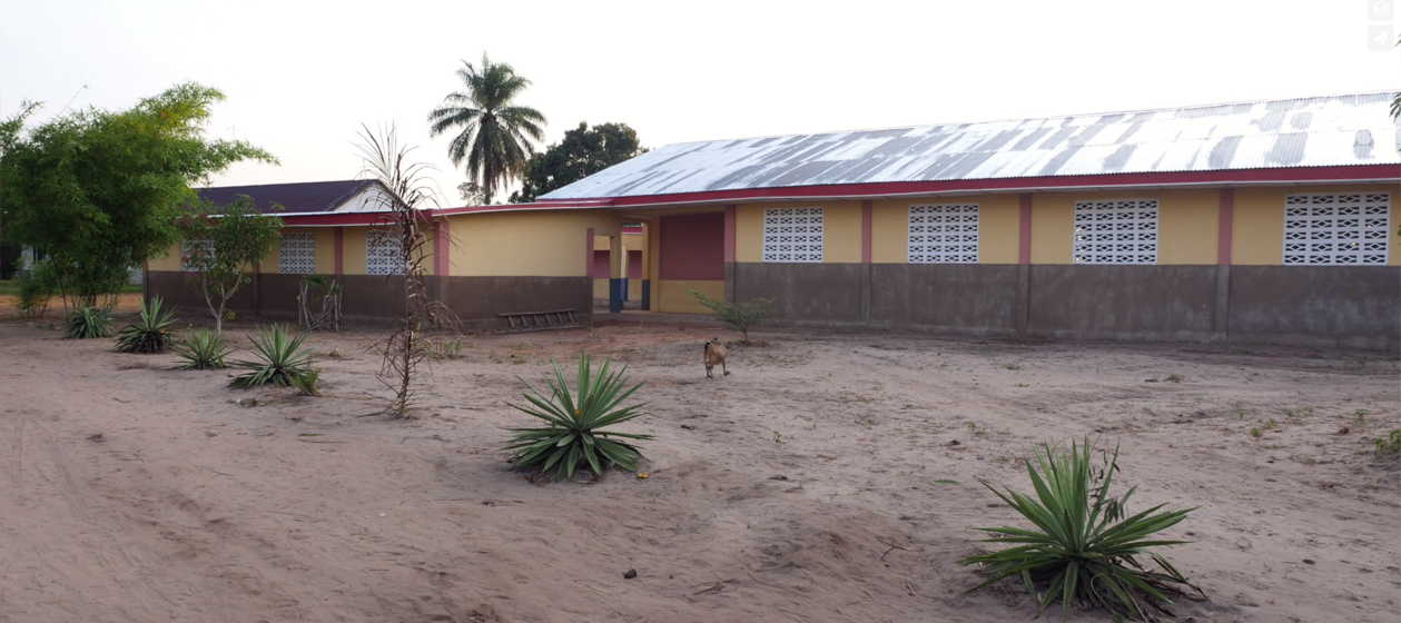 Multi-purpose building equipped with solar panels and two wings to house the library and the sewing program - 2018
