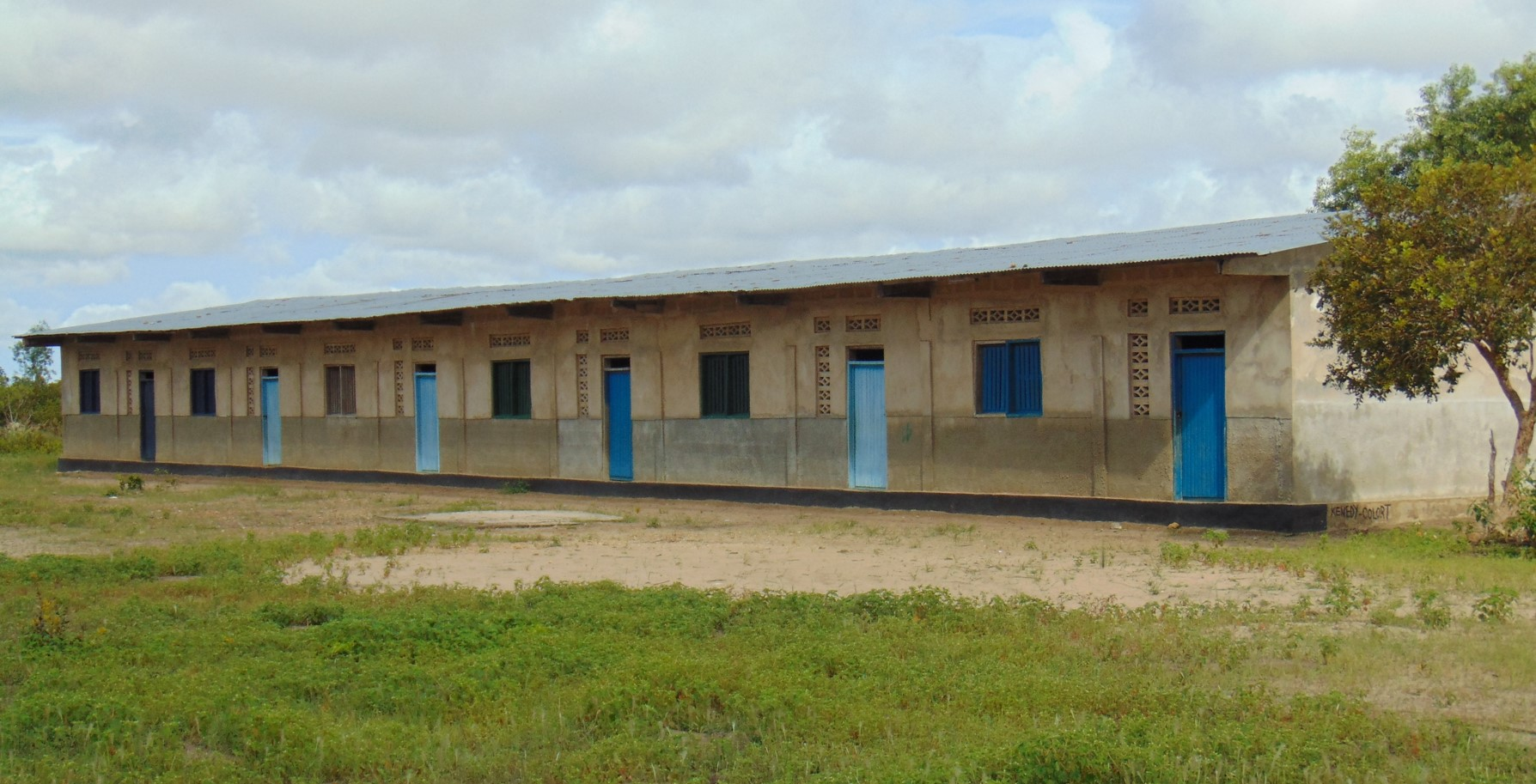 First six-classrooms cement-block building built completed in 2011.
