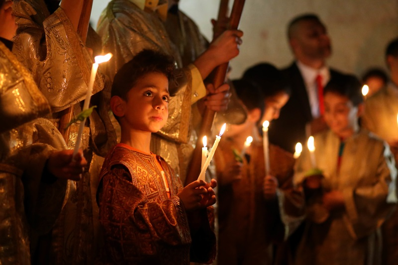 Palestinian Christians at St. Porphyrius Church in Gaza City celebrating Palm Sunday