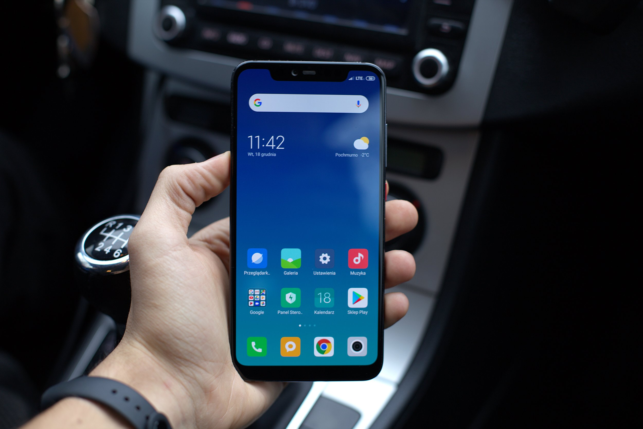 Picture of person holding phone in car
