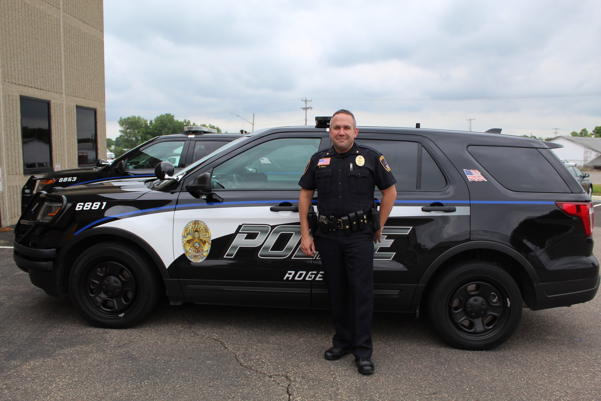 Picture of Chief Wills next to police car