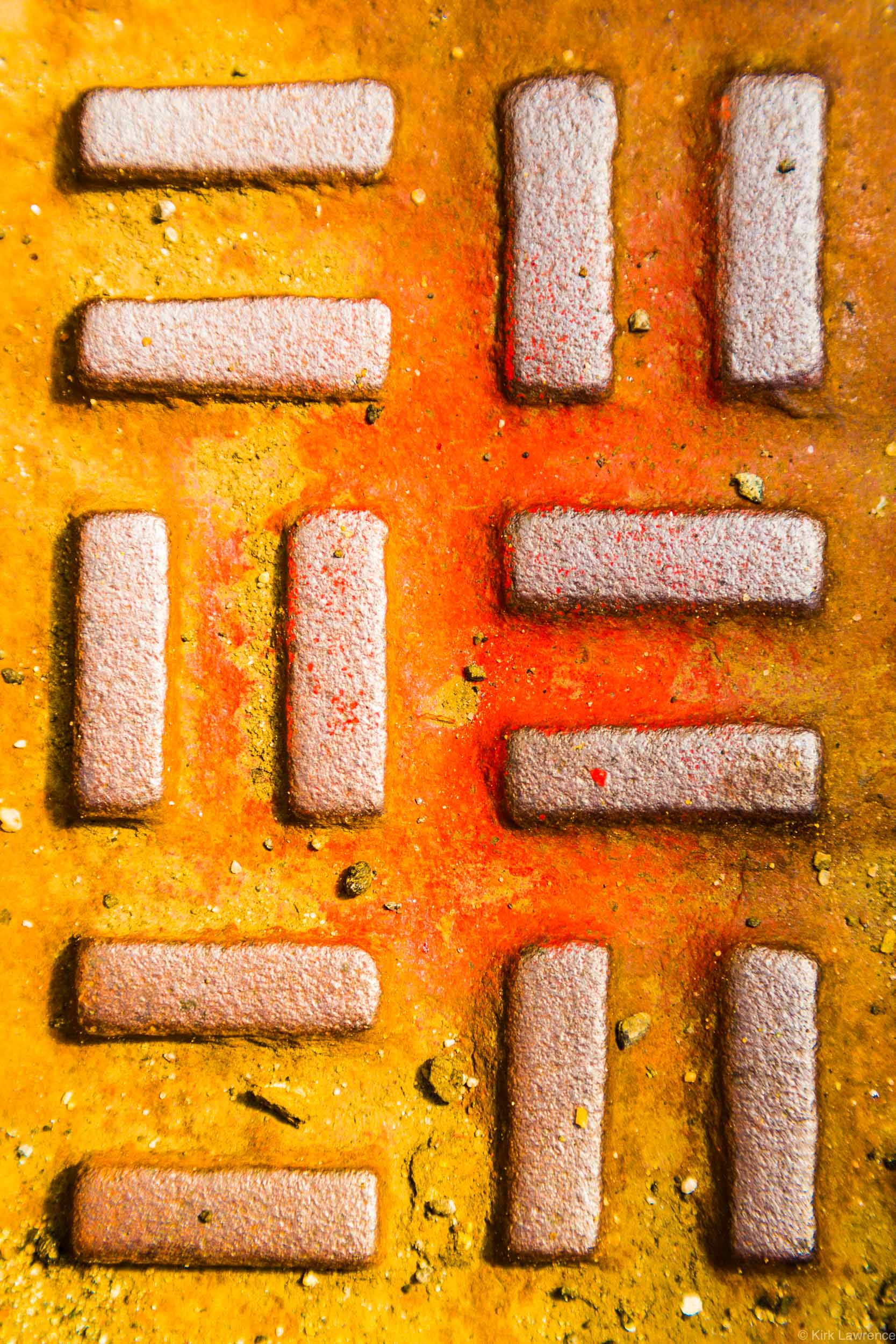 geometric_street_grate_yellow_orange.jpg