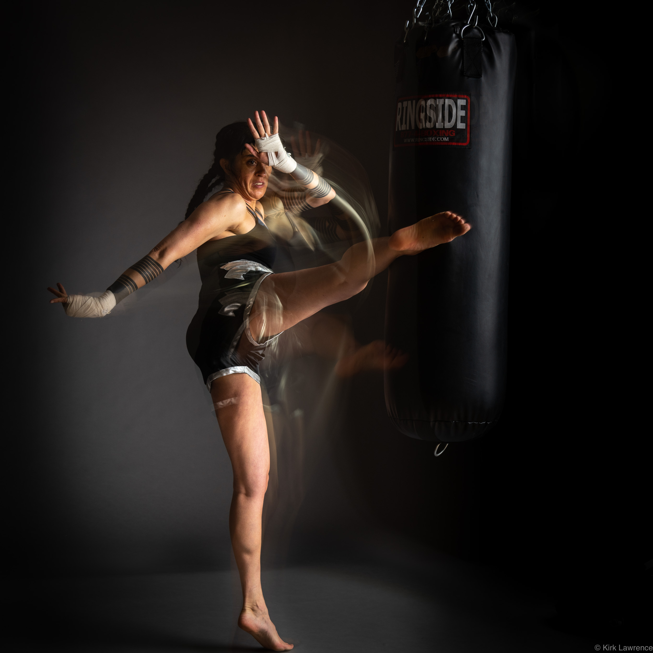 female_kickboxer_kicking_bag.jpg