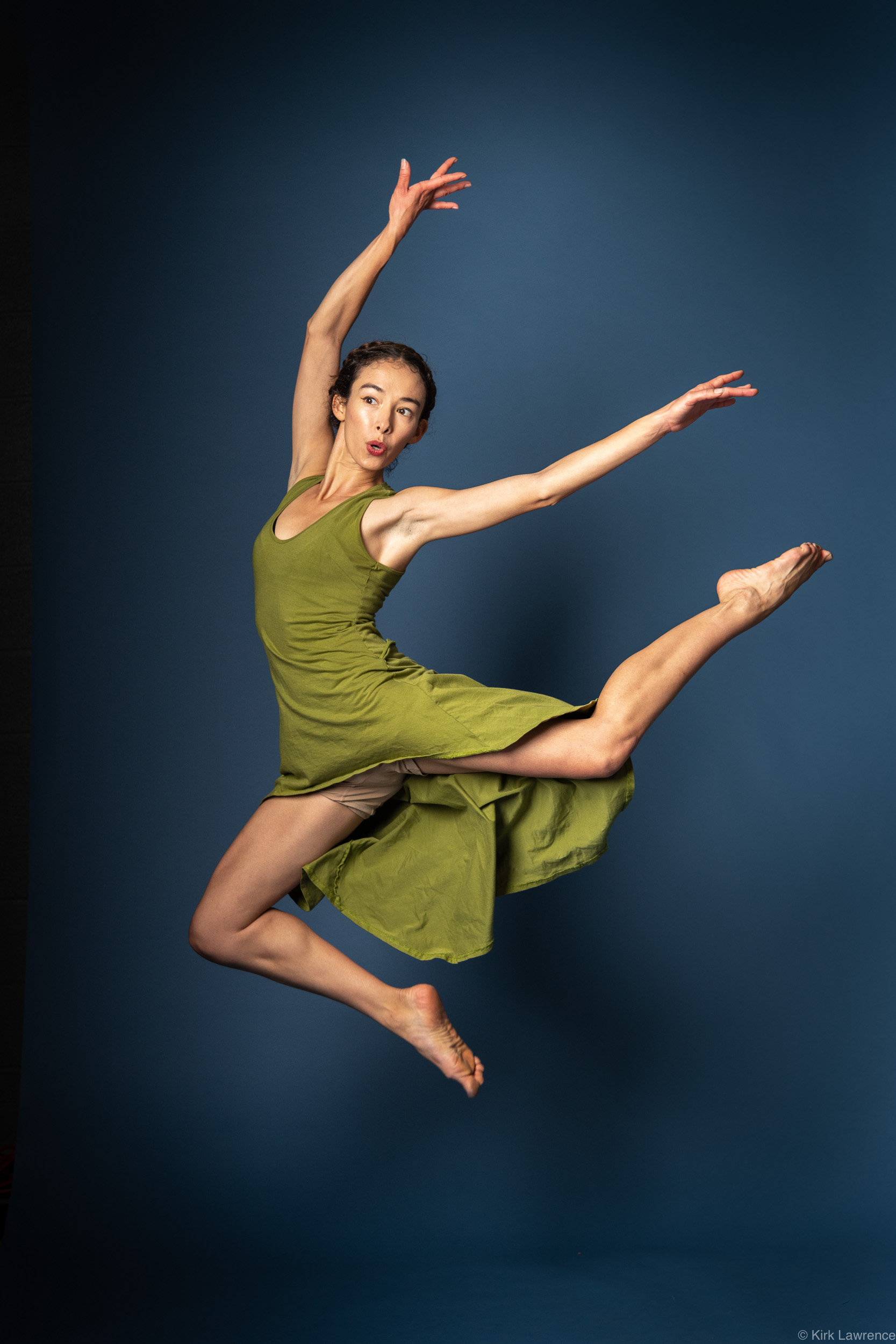 modern_dancer_jumping_green_dress.jpg
