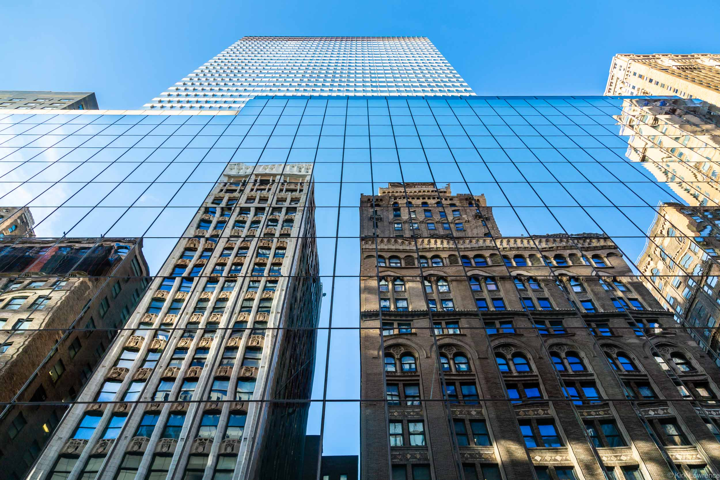 reflection_skyscraper_New_York_City_blue_sky.jpg