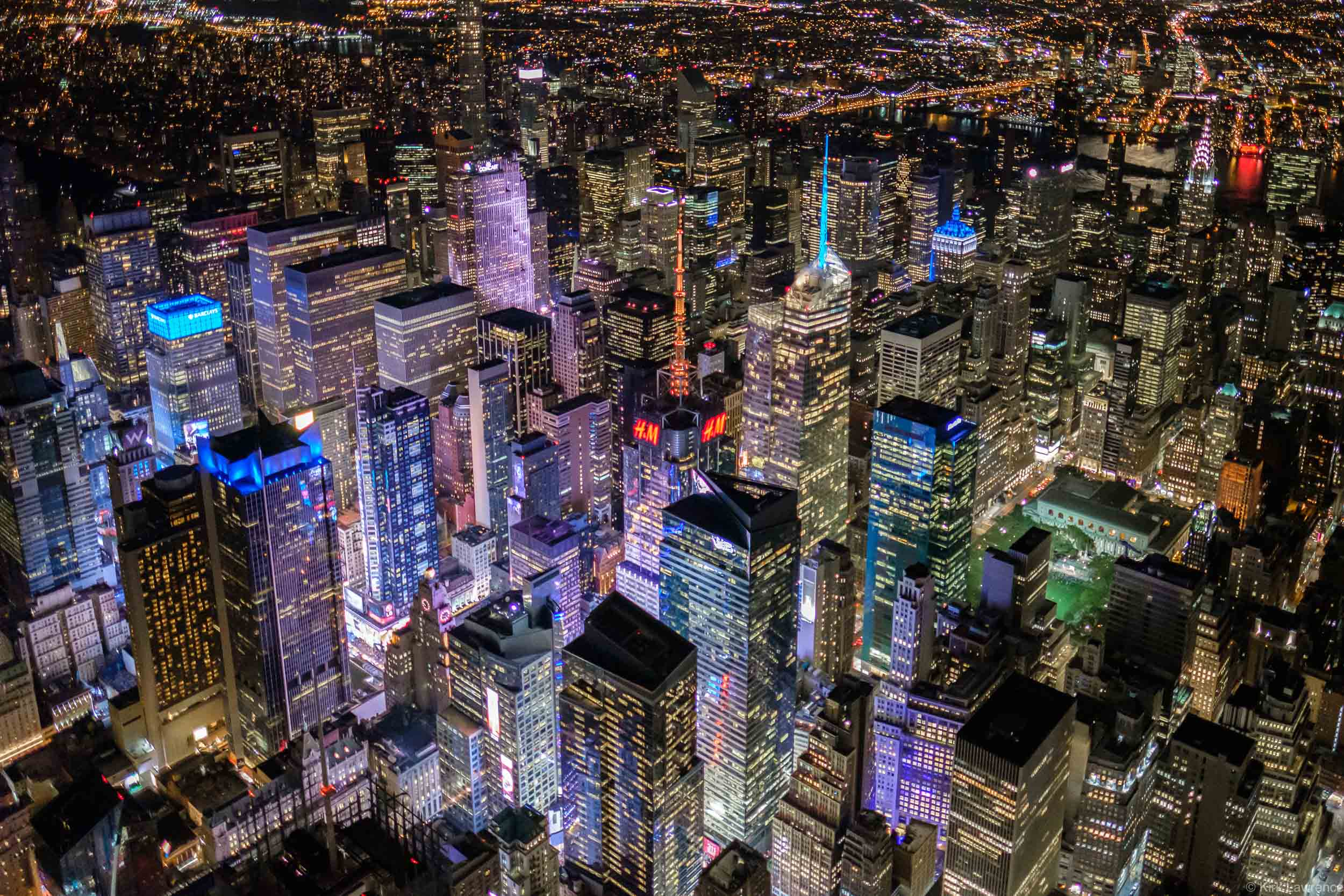 helicopter_view_Manhattan_Times_Square_New_York_City_nighttime.jpg