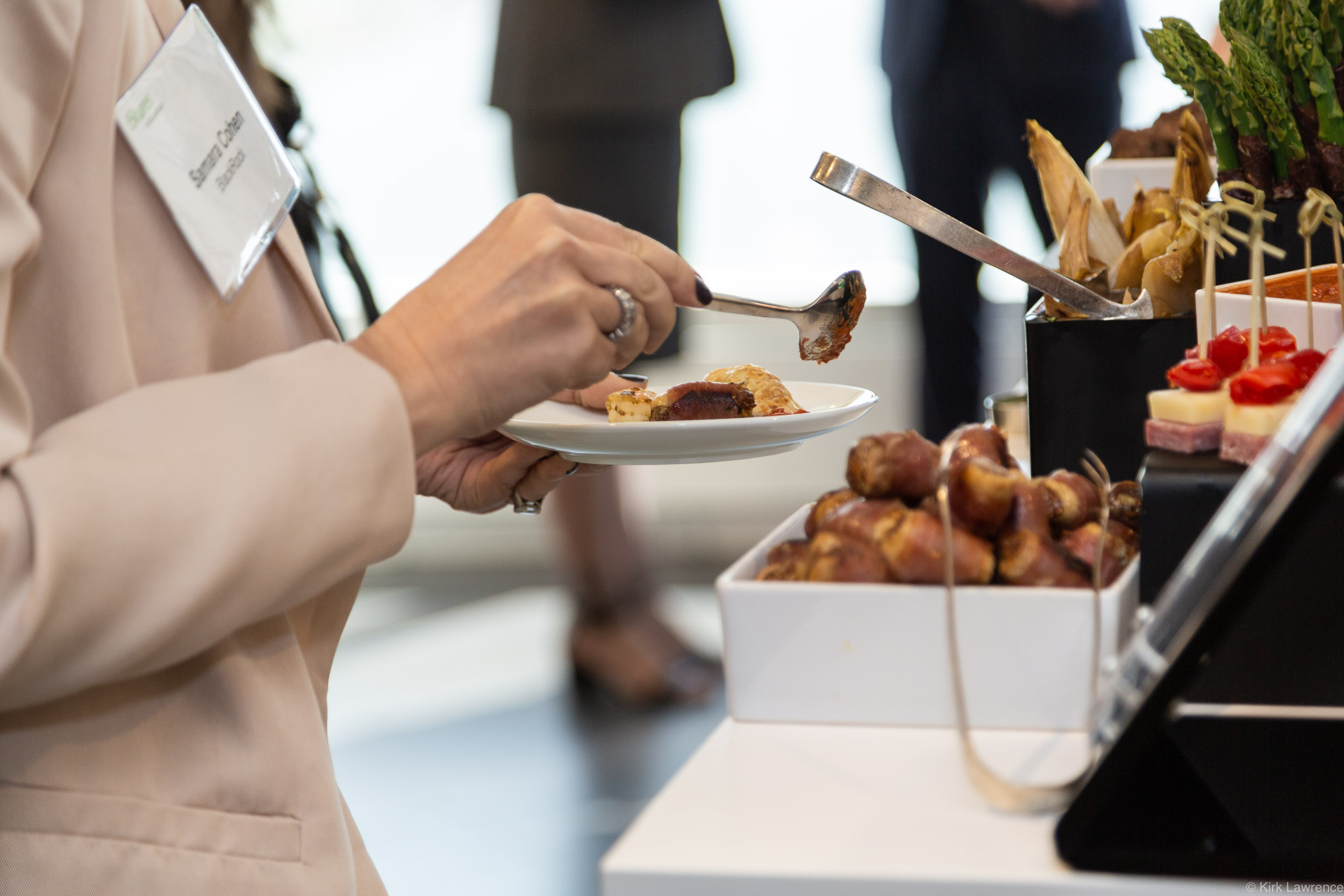 event_catered_food_appetizers_woman.jpg