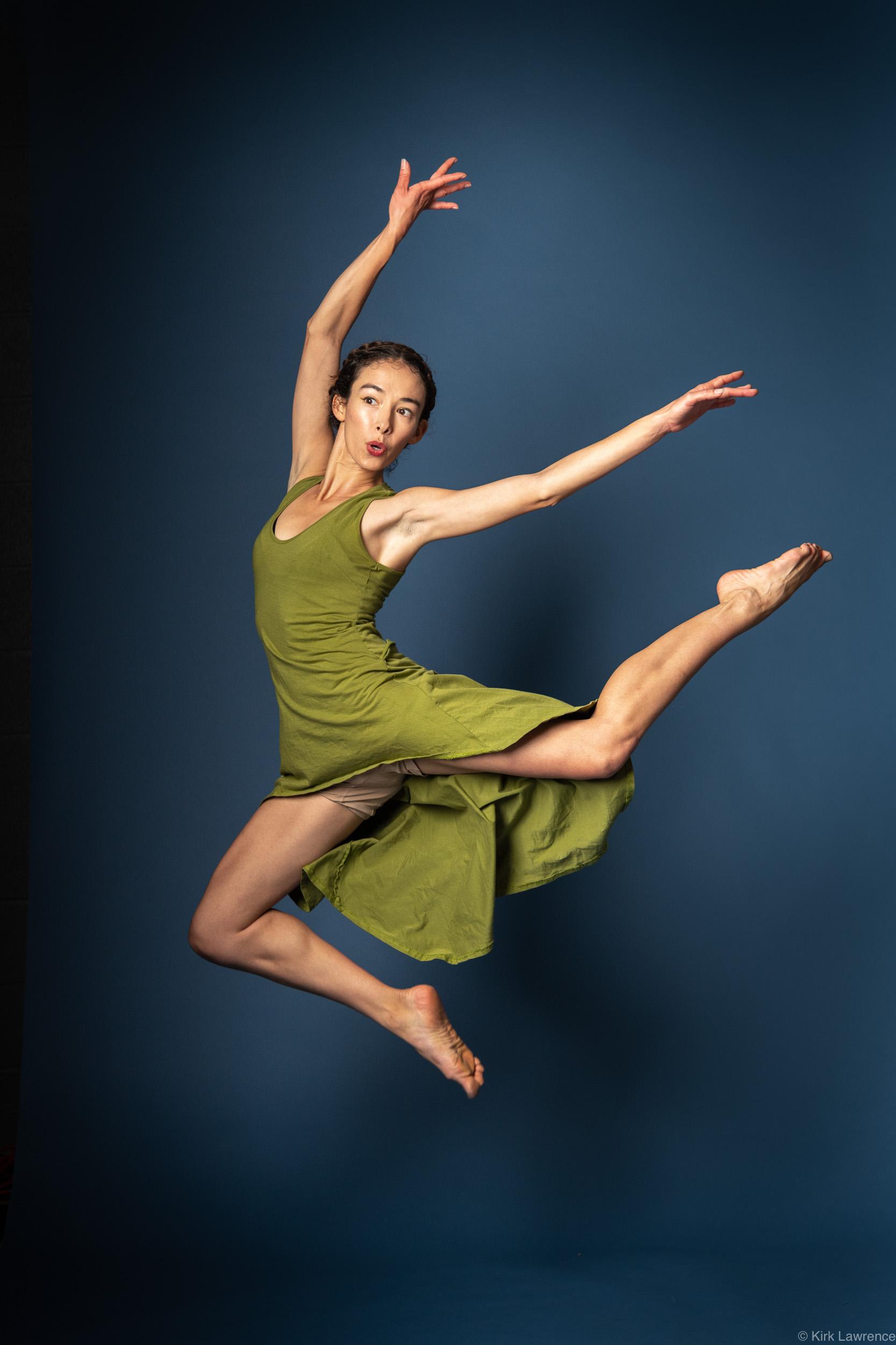 modern_dancer_jumping_green_dress_portrait.jpg
