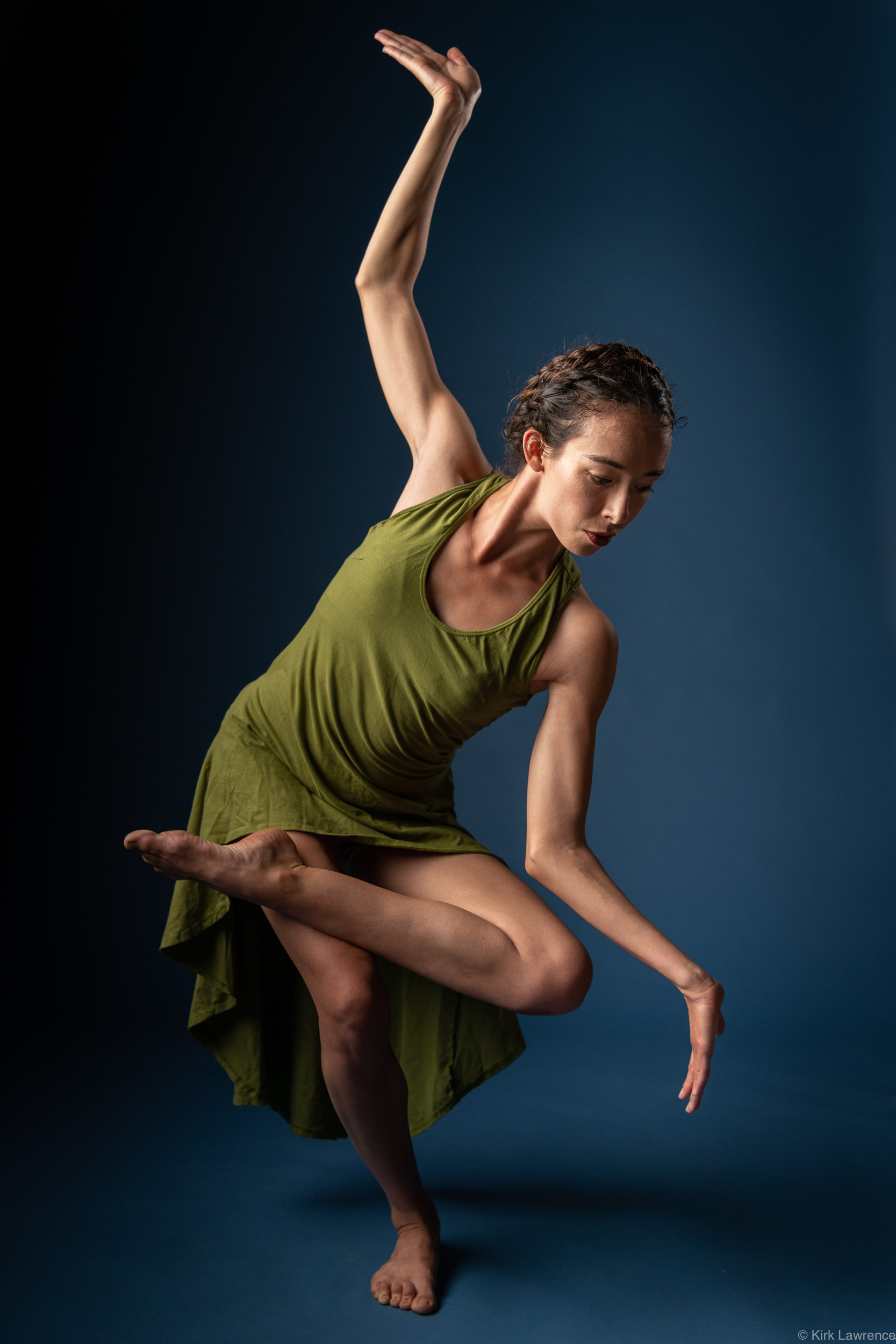 modern_dancer_balancing_green_dress_portrait.jpg