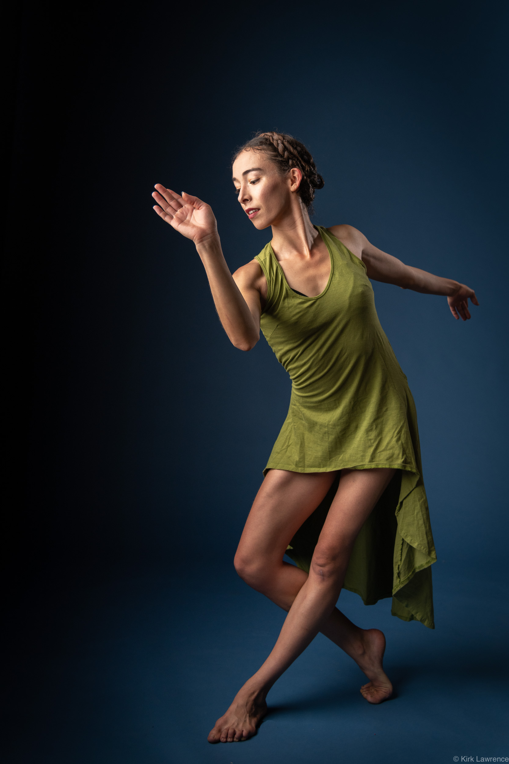 modern_dancer_green_dress_posing_portrait.jpg