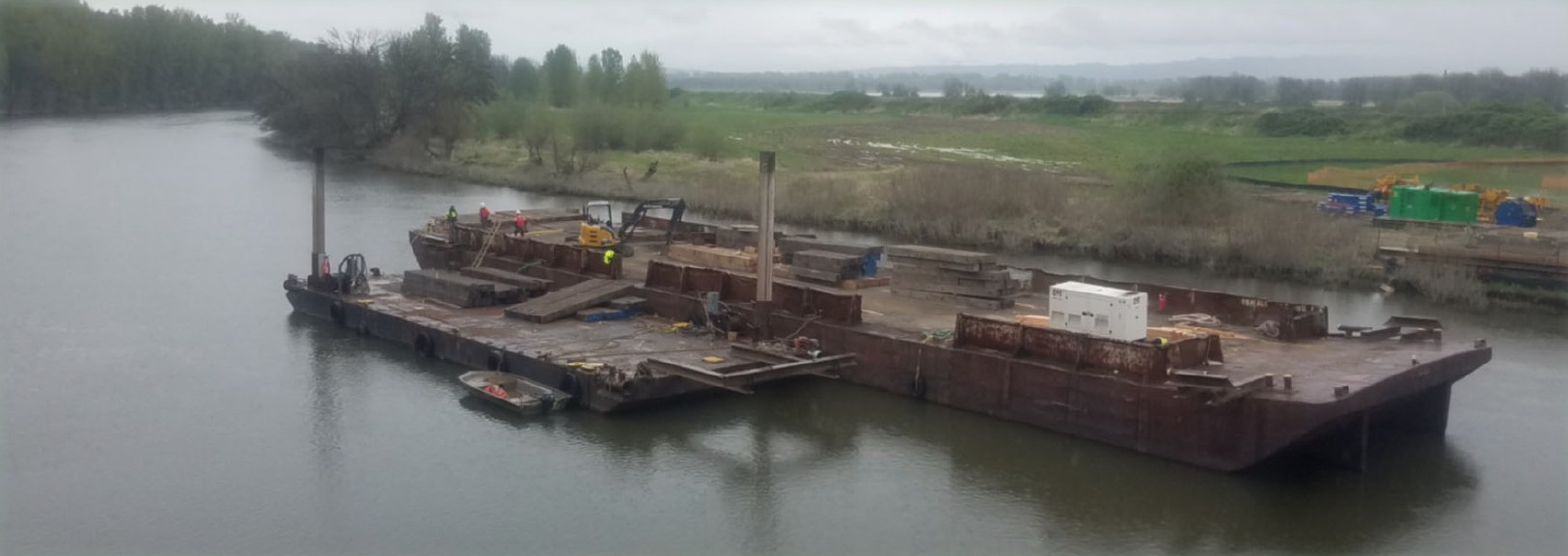 "This barge, known as the ""dance floor,"" will be used to hold the drills that will create two of the bridge piers."