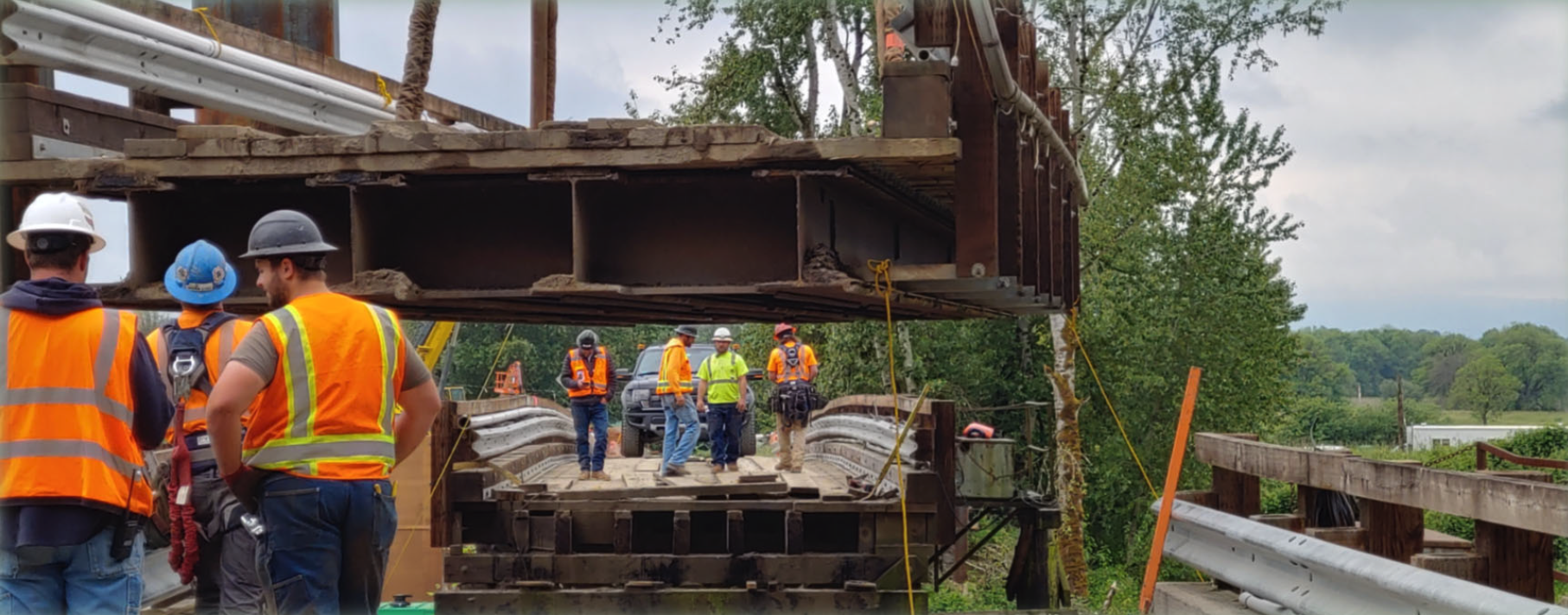 Crews remove the center span of the existing bridge to barge in a crane to work on the new bridge. Did you even know the old bridge could do that?! Don't worry about driving across it on the weekends, though. The old bridge was designed to have the center span removed for large vessels to pass.