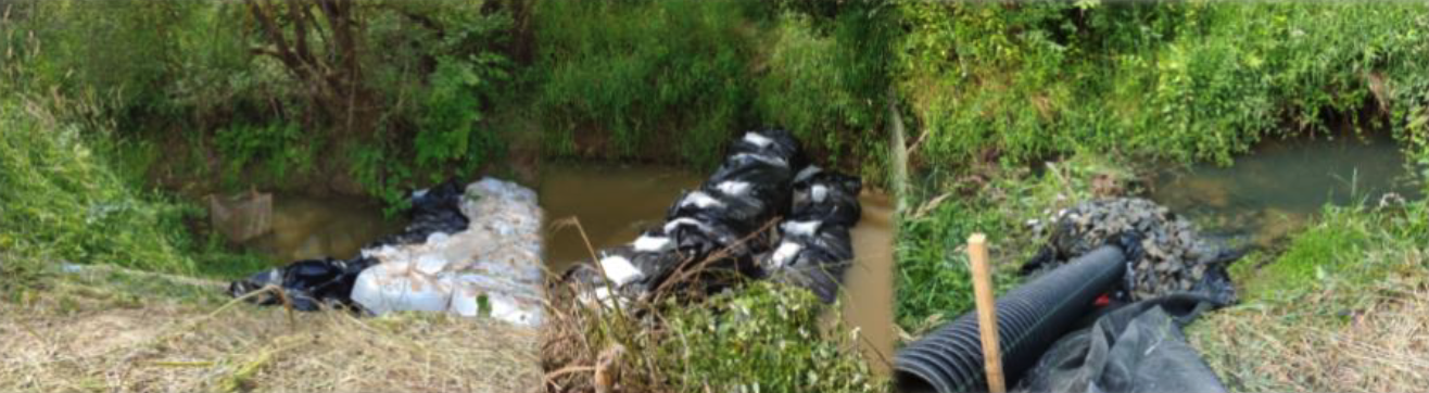 Features, like these filled bags, rock mounds, and tubes are in place to temporarily divert Gee Creek around the work site.