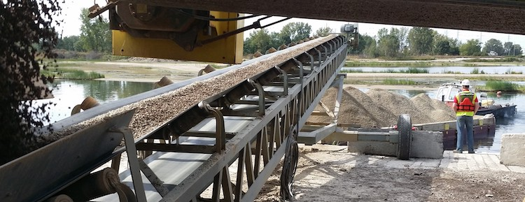 AquaBlok product delivery for dredge and active capping with conveyor.