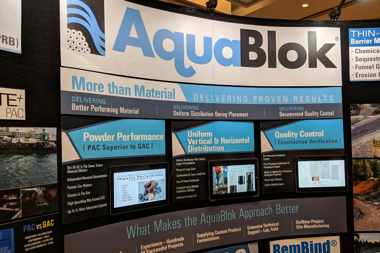 AquaBlok, Ltd's exhibit booth display at the 2019 Battelle Contaminated Sediments Conference highlighted three key benefits of their geotechnical sealing and sediment remediation materials: Powder Performance, Uniform Distribution, and Quality Control.