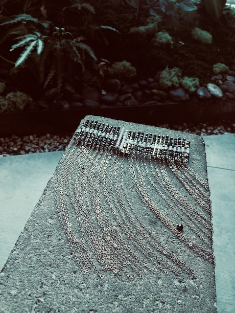 Waterfall necklace by  Simon Alcantara  adds a special touch to a white crisp button down shirt or a black dress that needs something special with a delicate and beautiful feeling. The necklace makes a statement that is not overpowering.  Photography by Crystal Quezada.