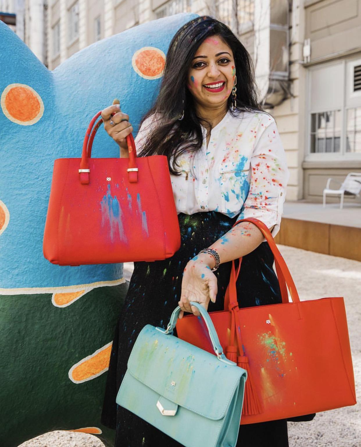 Designer Sugandh G. Agrawal with her GUNAS bags.
