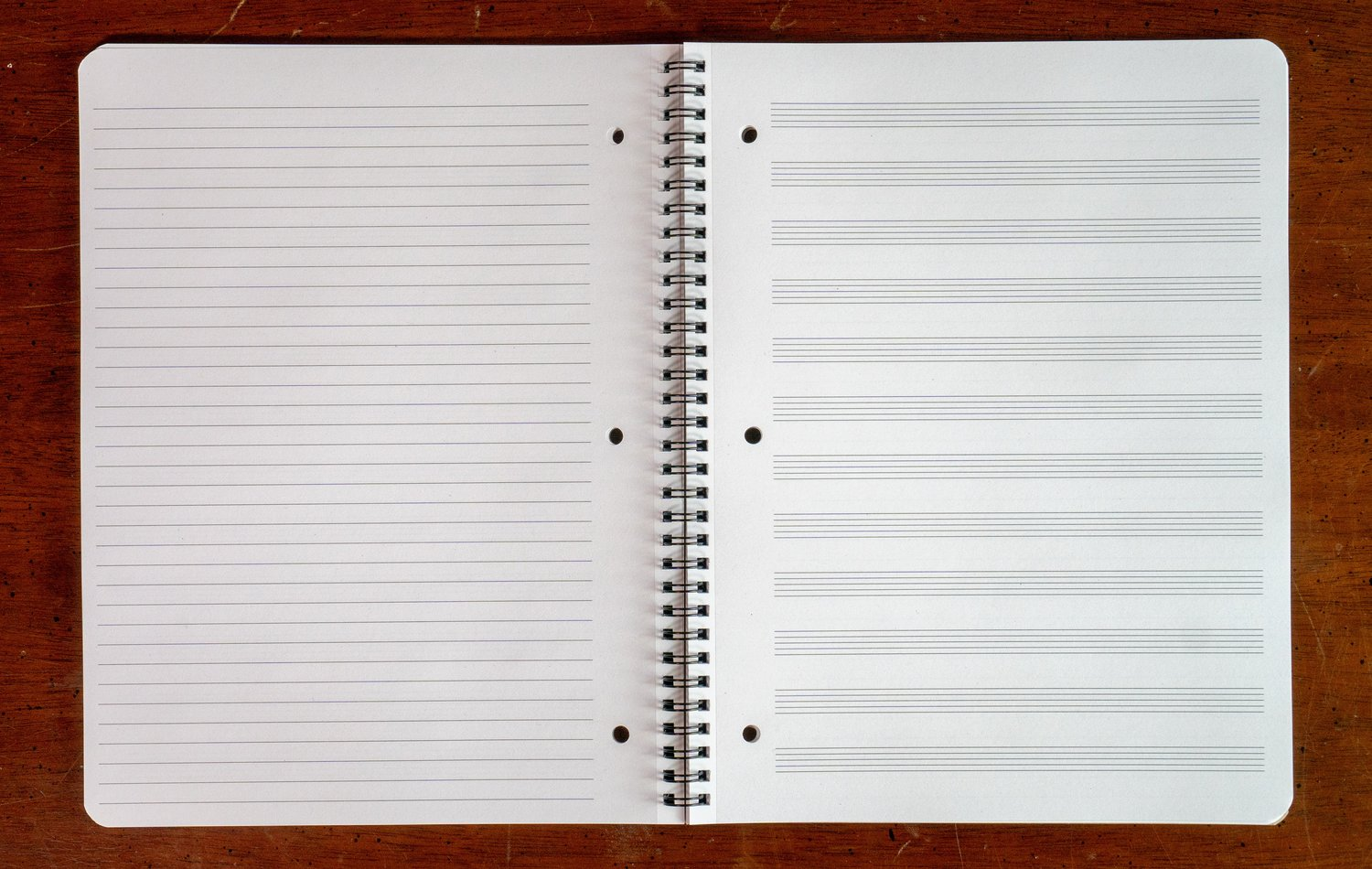 The Ruled Edition - College-ruled lines on the left, 12 staves on the right, and each page is perforated and three-hole-punched.