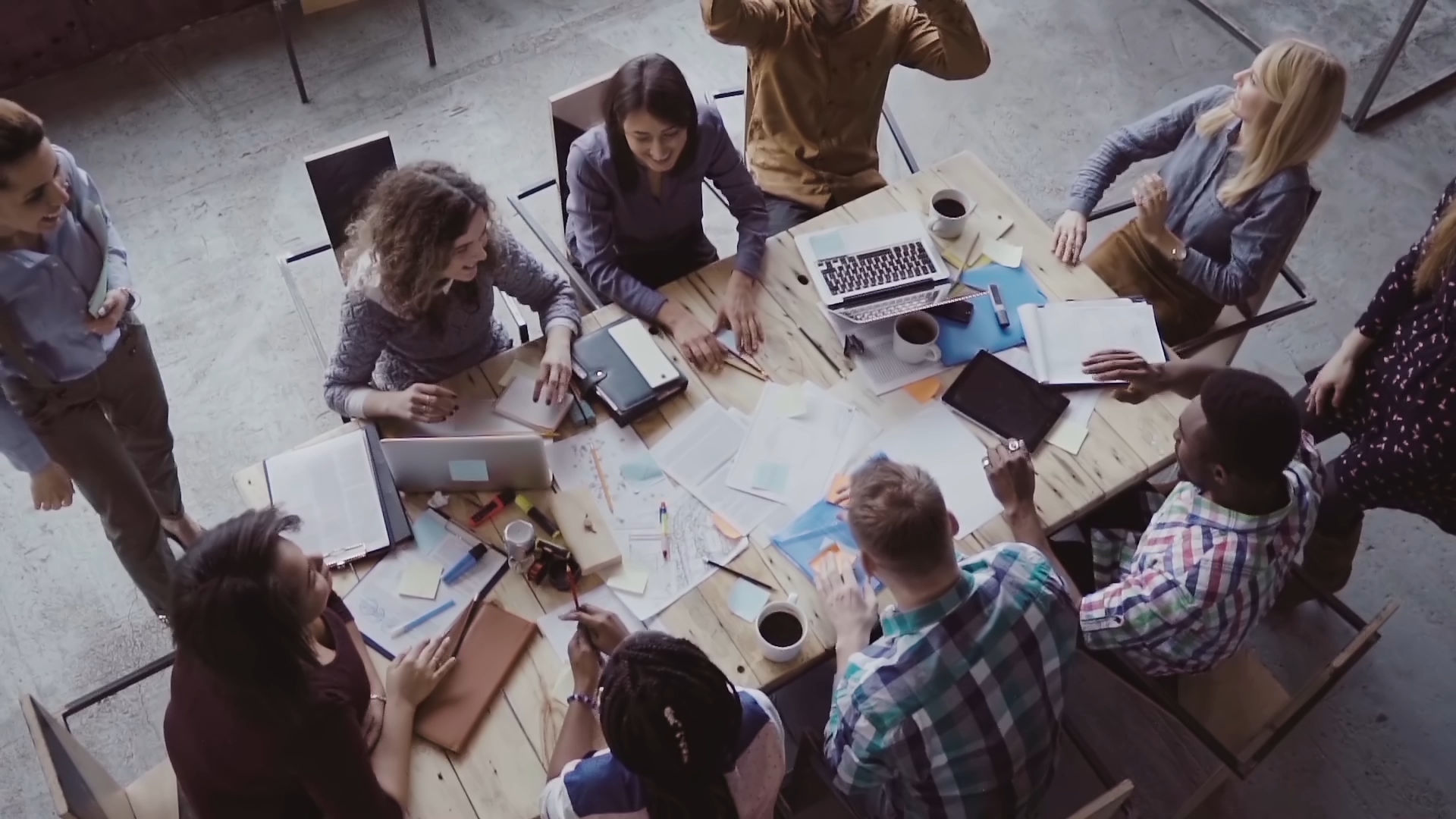 videoblocks-top-view-of-business-team-working-at-office-young-mixed-race-group-of-people-puts-palm-together-on-centre-slow-mo_B8rhp1VNG.mov.00_00_17_05.Still001.png