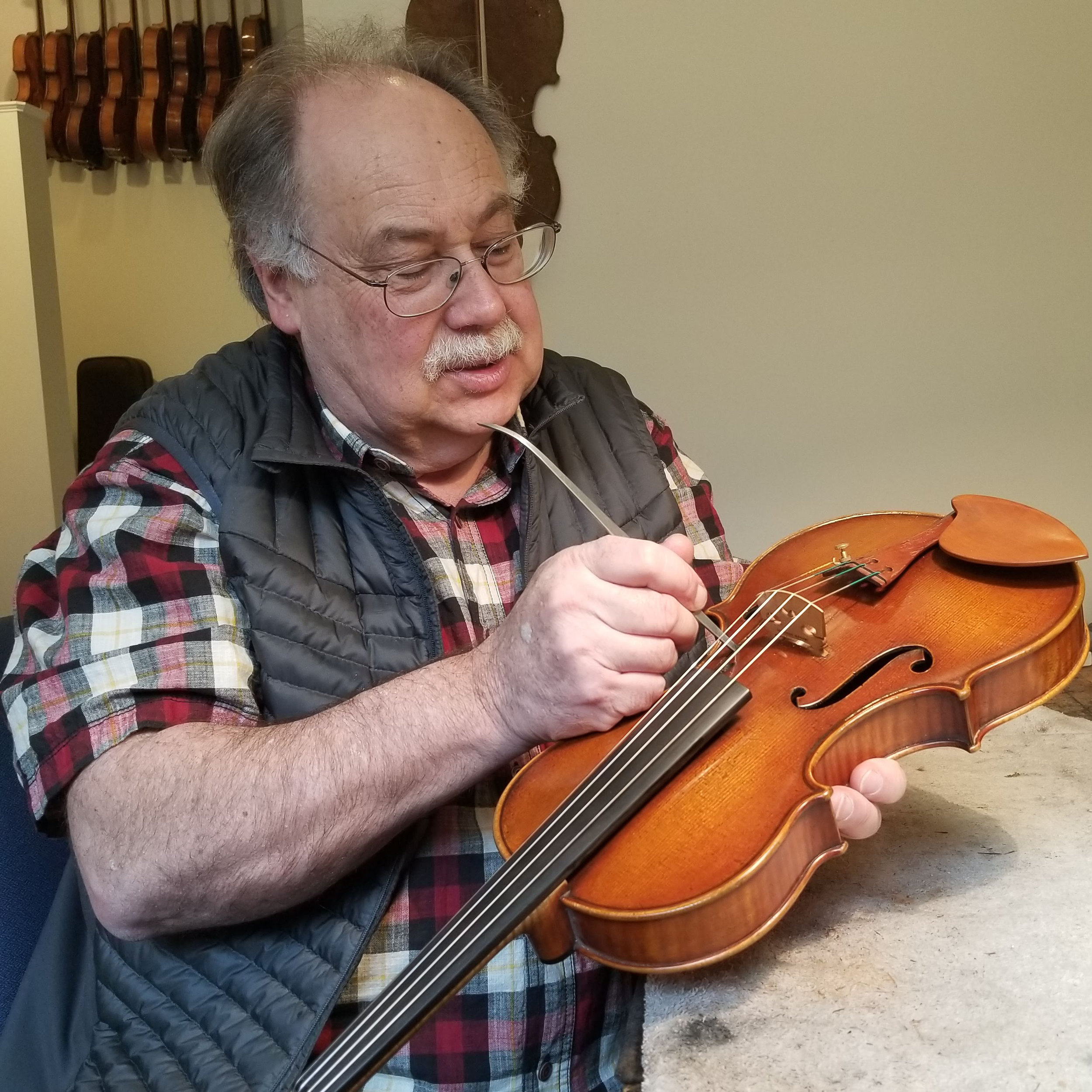 Paul Wiessmeyer - Paul Wiessmeyer has owned and operated a studio in Boston since 1990.Before opening Wiessmeyer Violins LLC, Paul trained at the violin making school in Mittenwald Germany. Upon graduation, in 1981, Paul worked for several violin shops in Europe and the US, most notably for Vladimir Pilar in Czechoslovakia and Hans Weisshaar in Hollywood, CA.During this period he honed his skills in repair, restoration, and sound adjustment, while continuing to make new instruments. Paul's instruments have received international recognition in competitions, most notably a gold medal at the H. Wienawski Violin Competition in Poland (1981), and gold medals for violin, viola, and cello at the VSA International Violin Competition in Salt Lake City (1982/ hors concours).Throughout his career, Paul has placed a strong emphasis on delivering quality craftsmanship and services tailored to the needs of his clients at affordable prices. In recent years, he has begun sharing his knowledge and expertise with others. In the summer, he teaches repair and set-up at the Violin Craftsmanship Institute of the University of New Hampshire and can now also be found instructing short seminars in the art of retouch across the US and Canada.